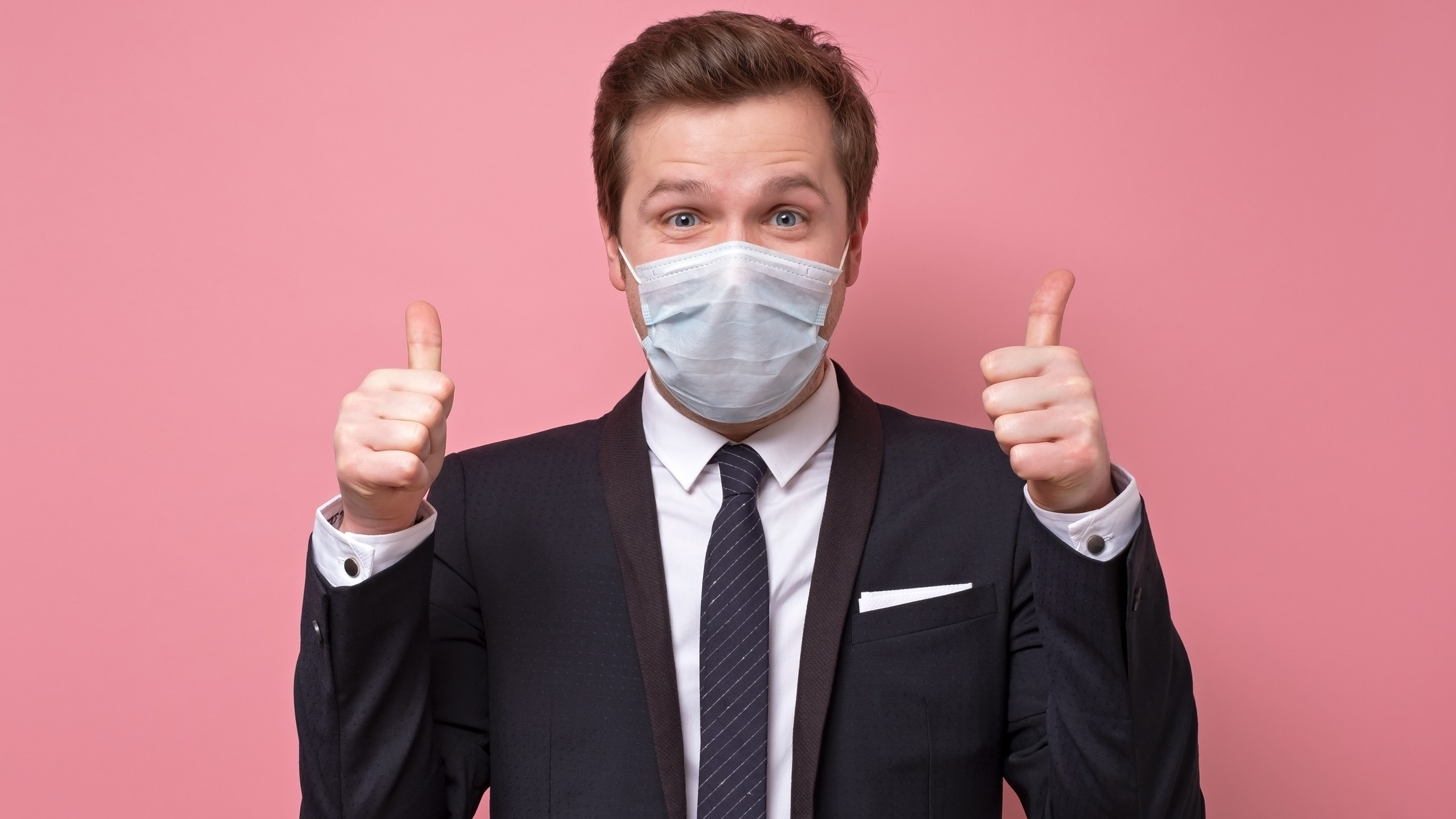 covid asx share price represented by man in face mask giving thumbs up