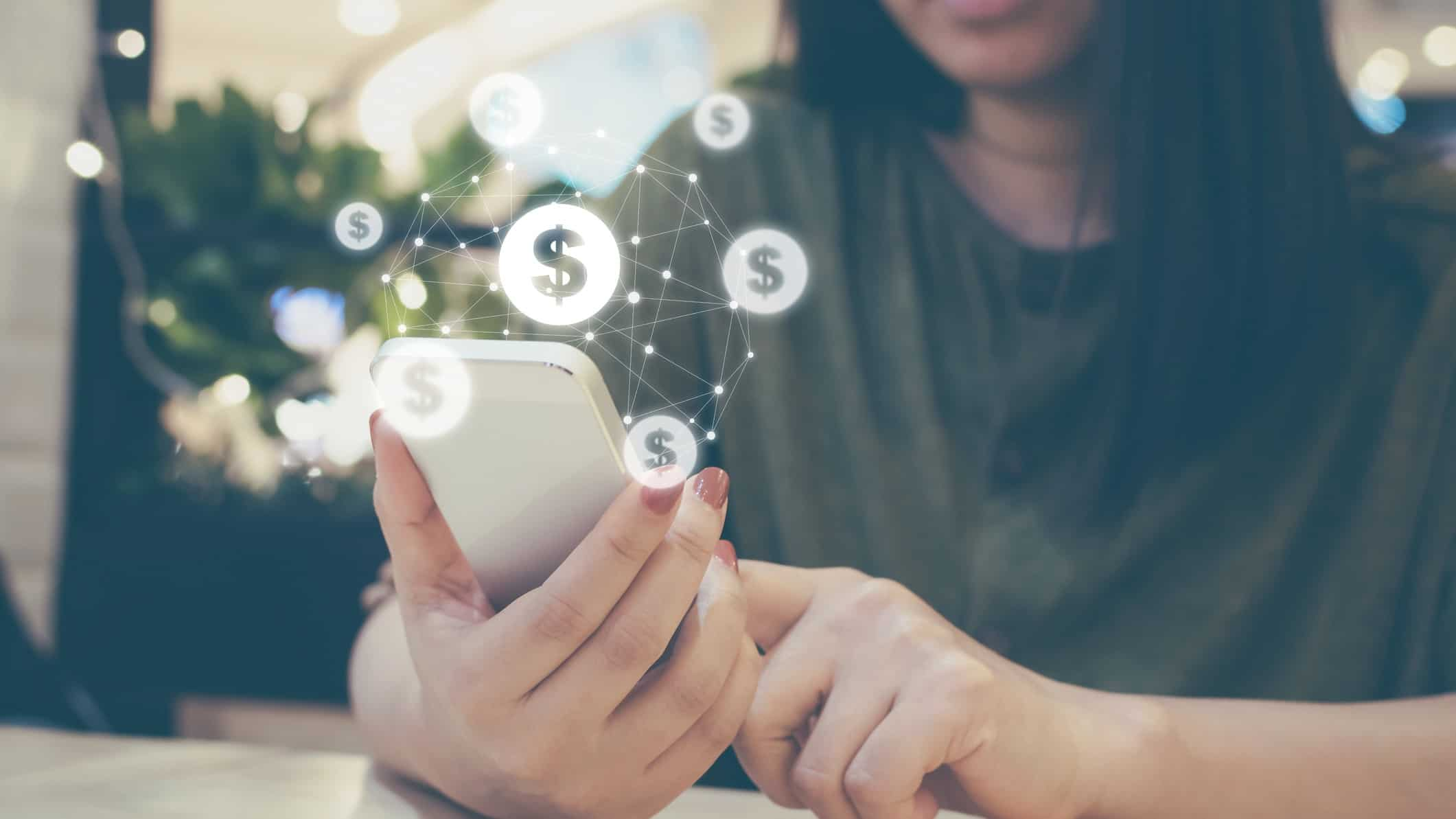 Woman holding smartphone with digital payment capability