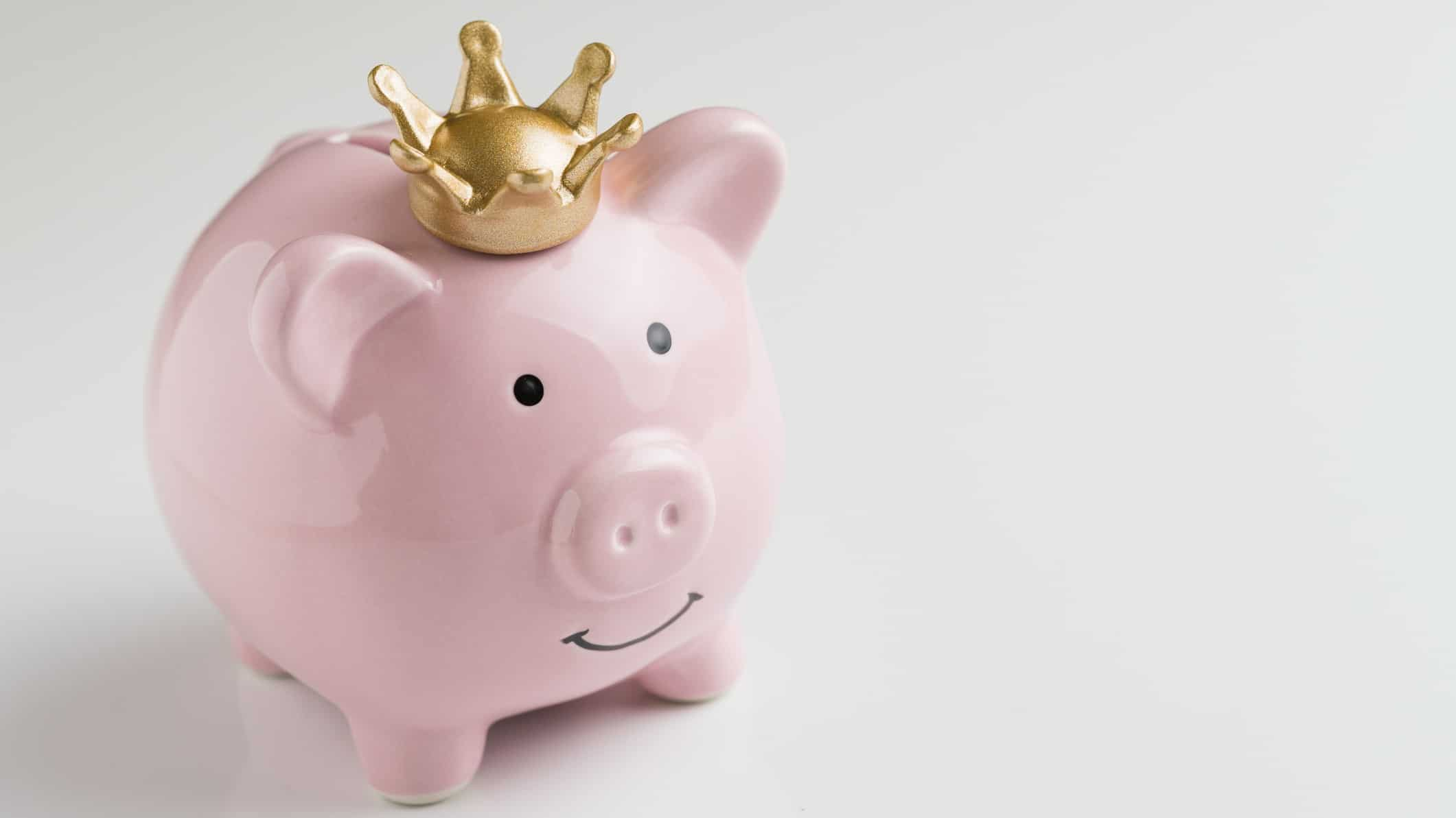 piggy bank wearing crown representing asx share dividend king
