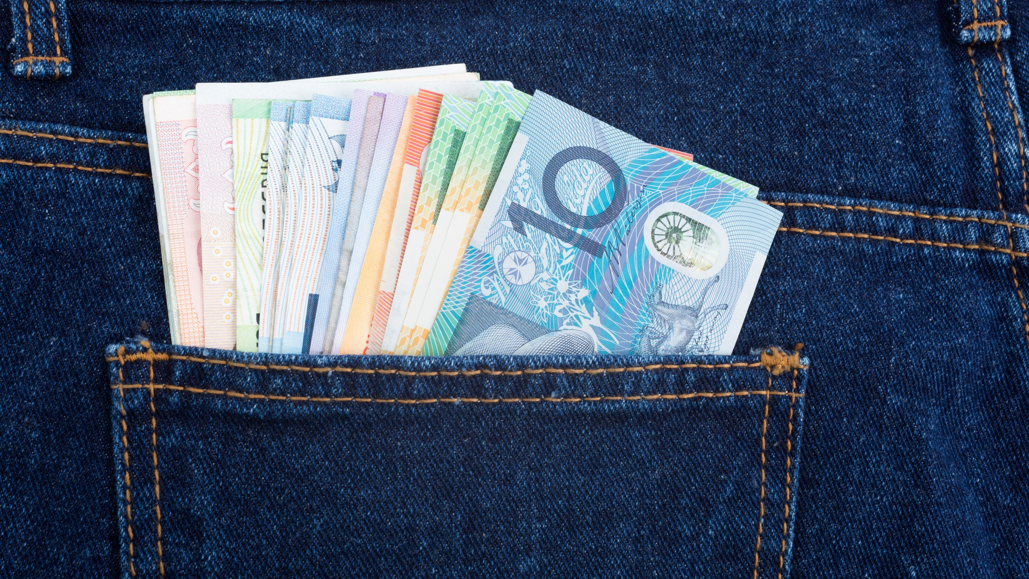 ASX dividend shares represented by cash in jeans back pocket