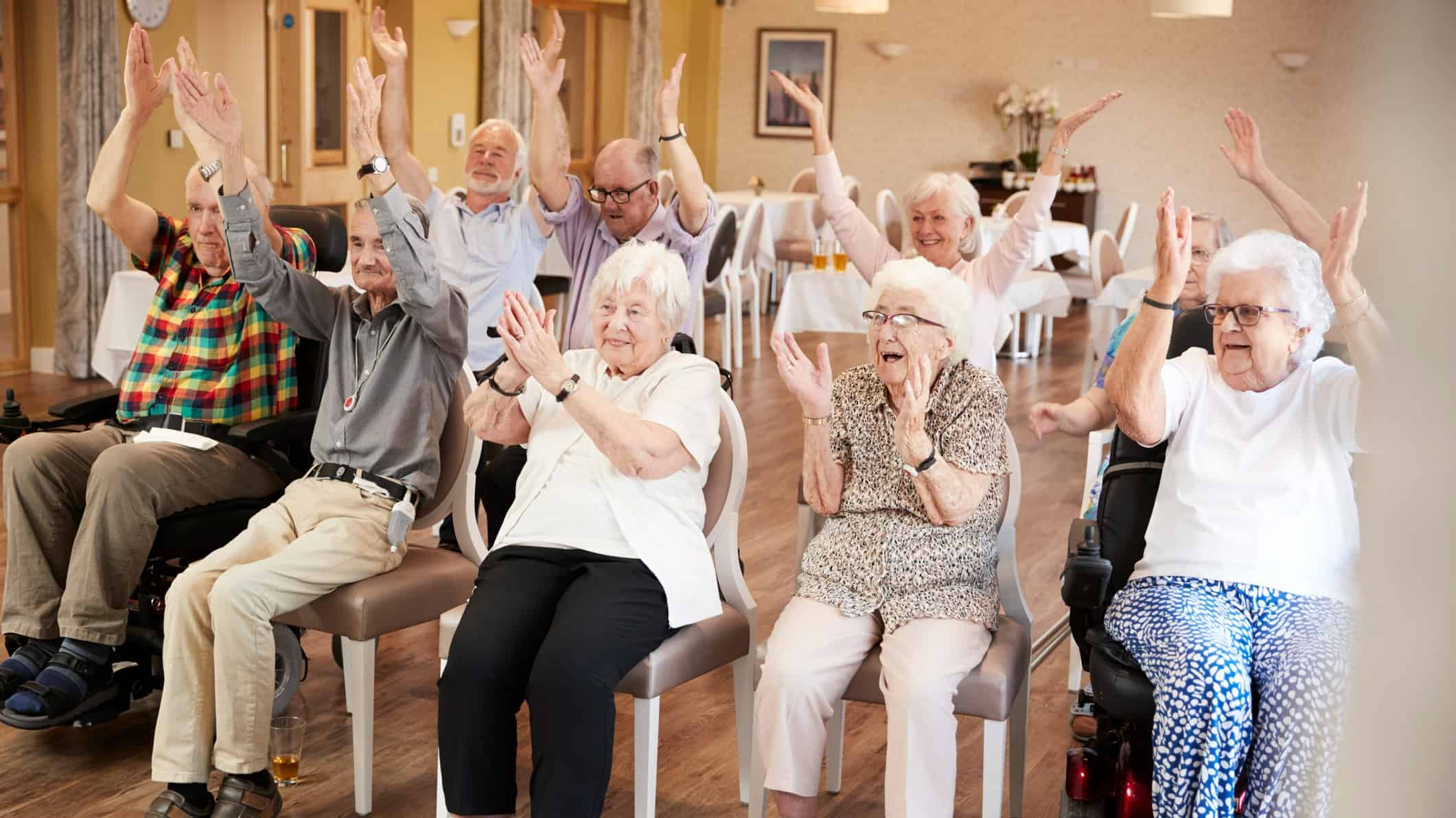 group of seniors happily clapping representing rising eureka share price