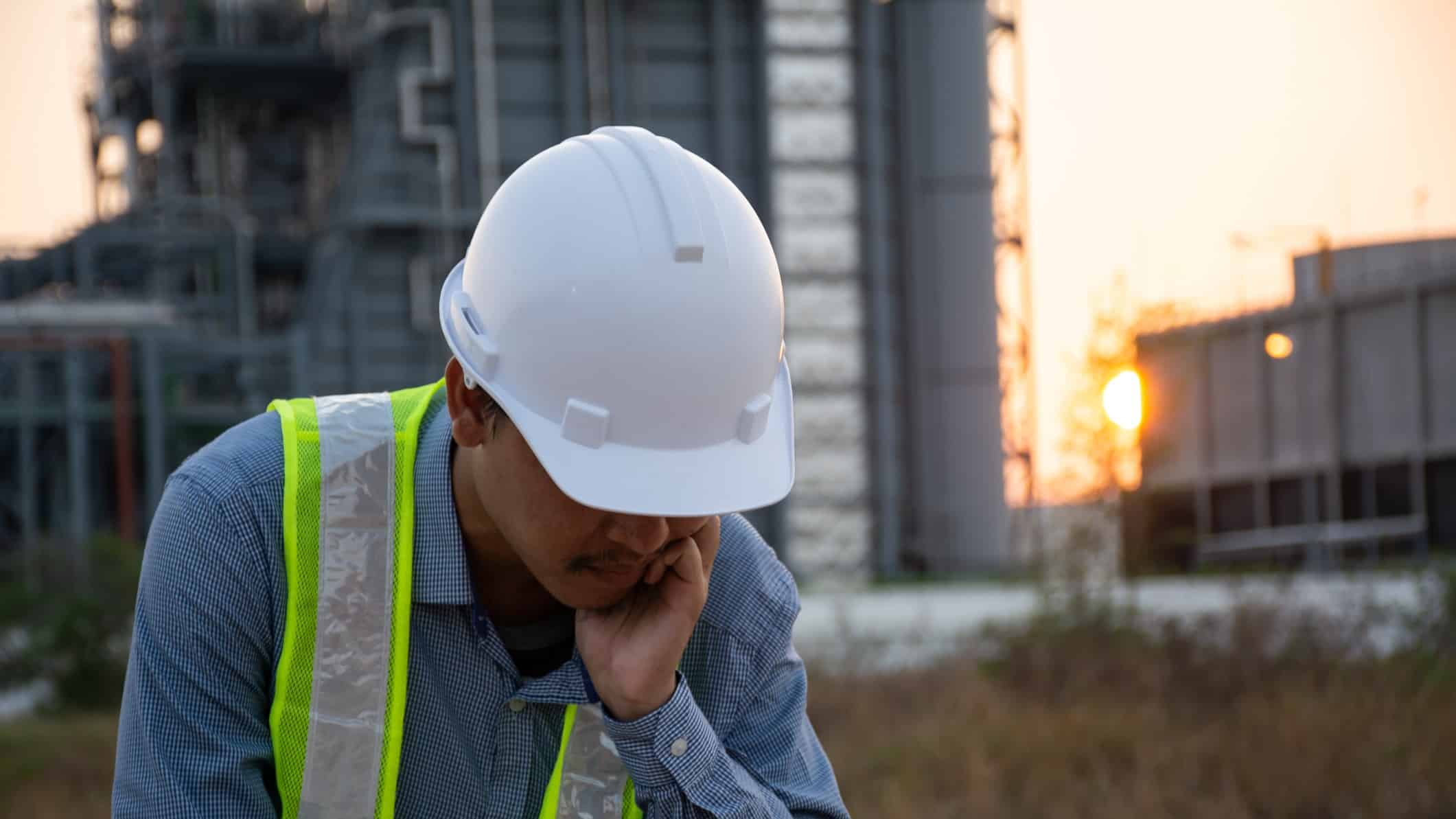 falling infrastructure asx share price represented by disheartened looking builder on work site