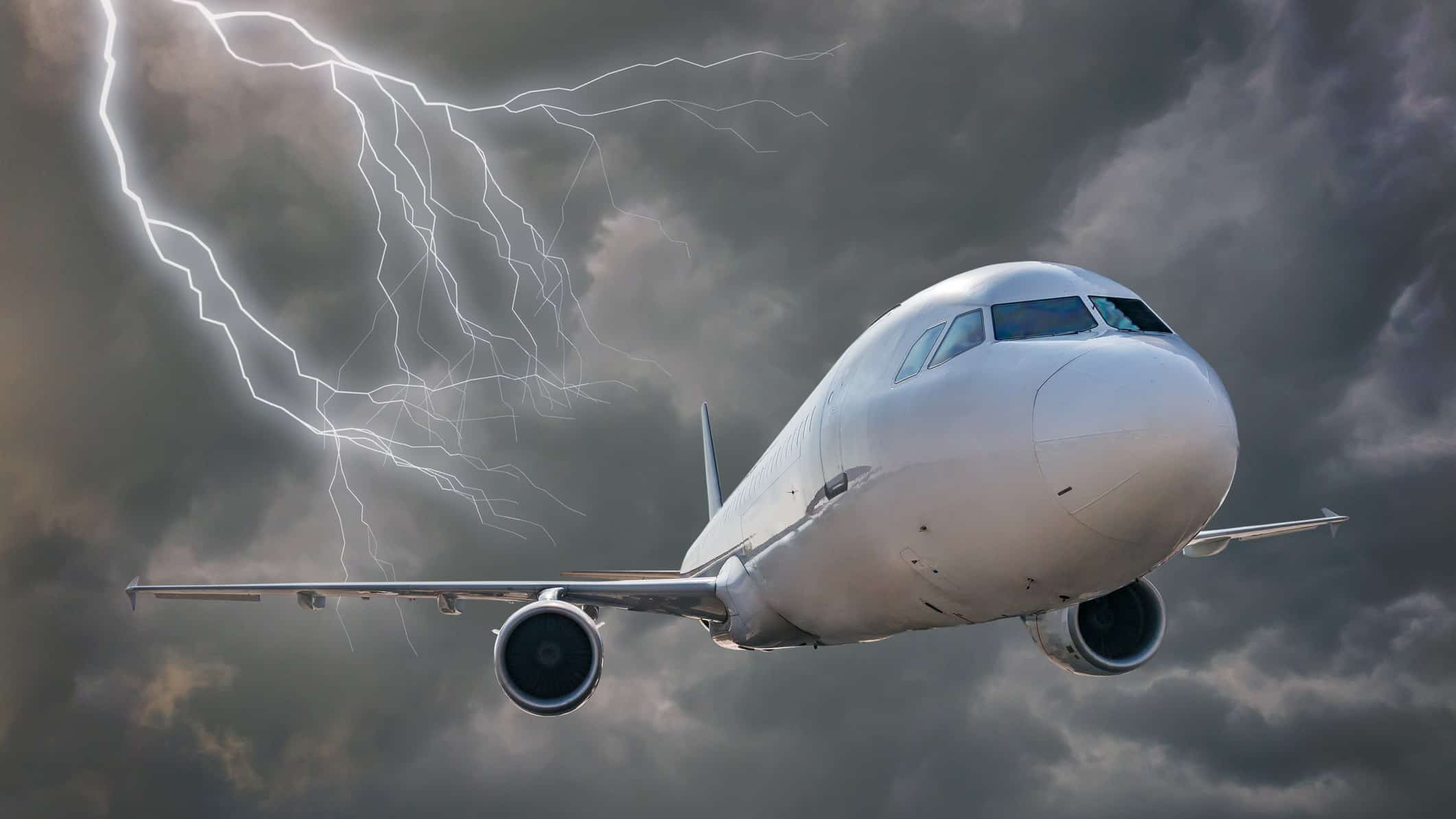 poor flight centre share price represented by plane flying away from lightening storm