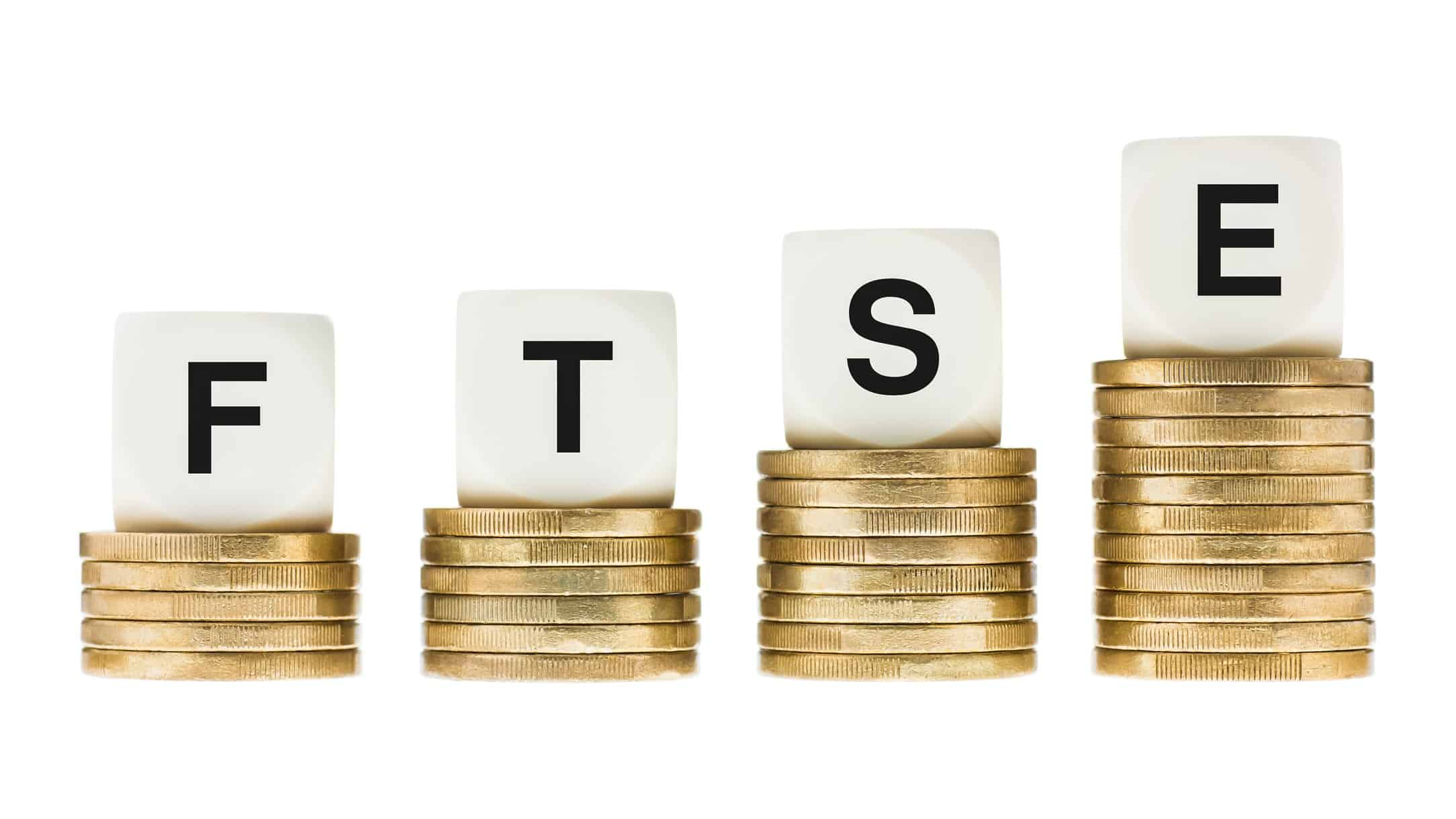 letter blocks spelling FTSE sitting atop growing piles of coins representing FTSE ETF