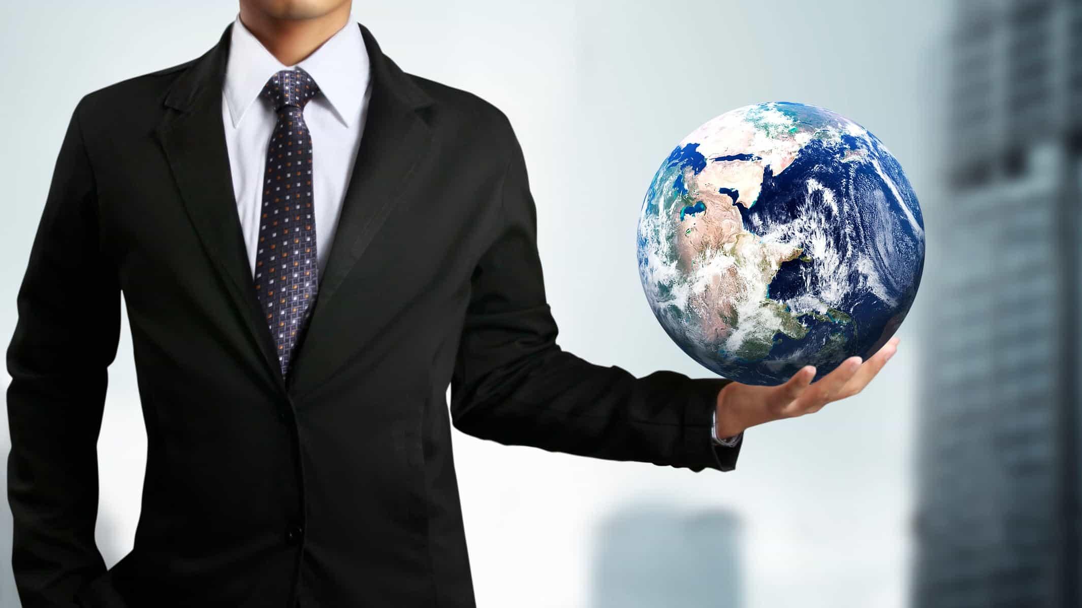 businessman holding world globe in one hand, representing asx etfs