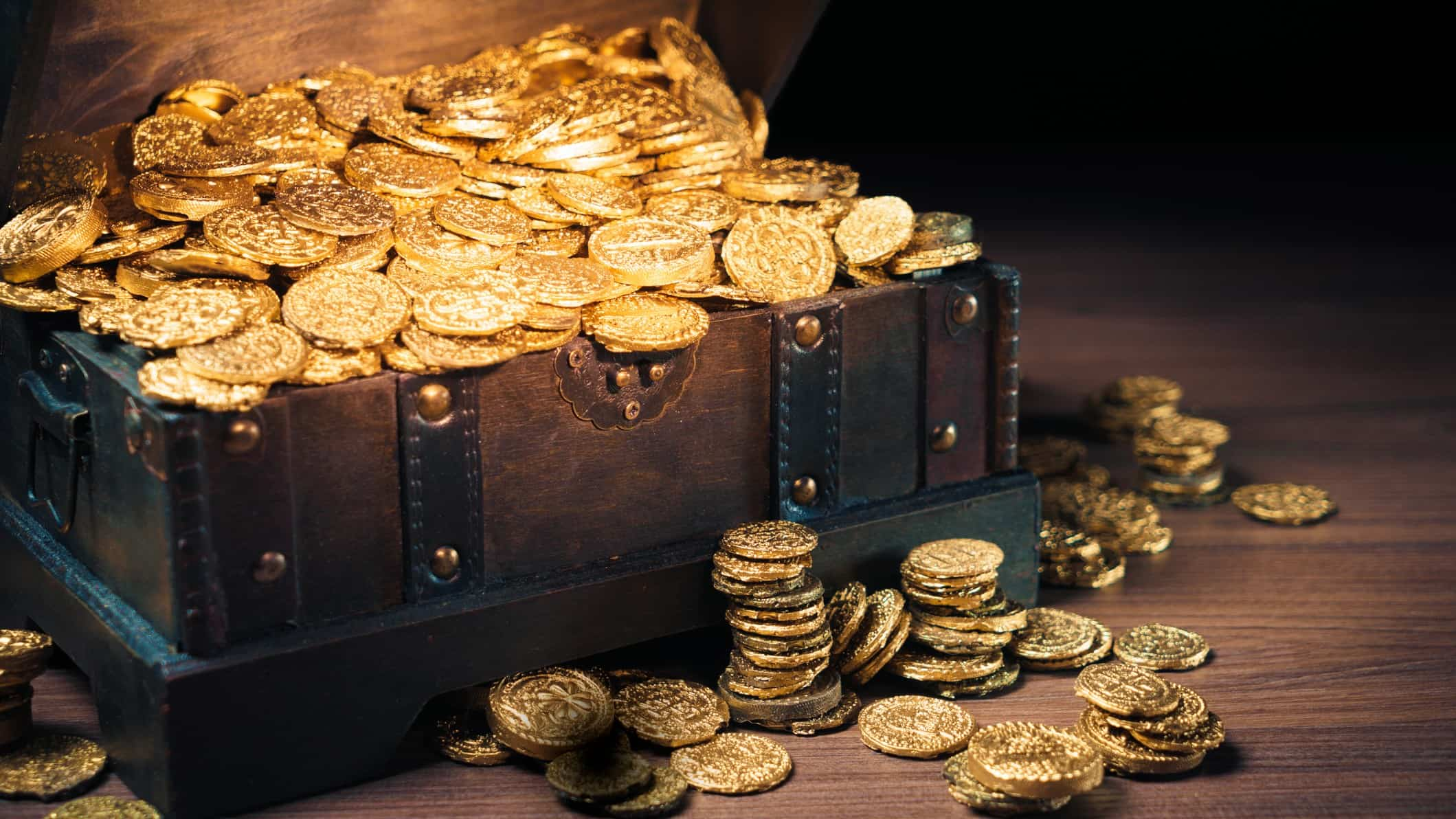 Old chest filled with gold coins