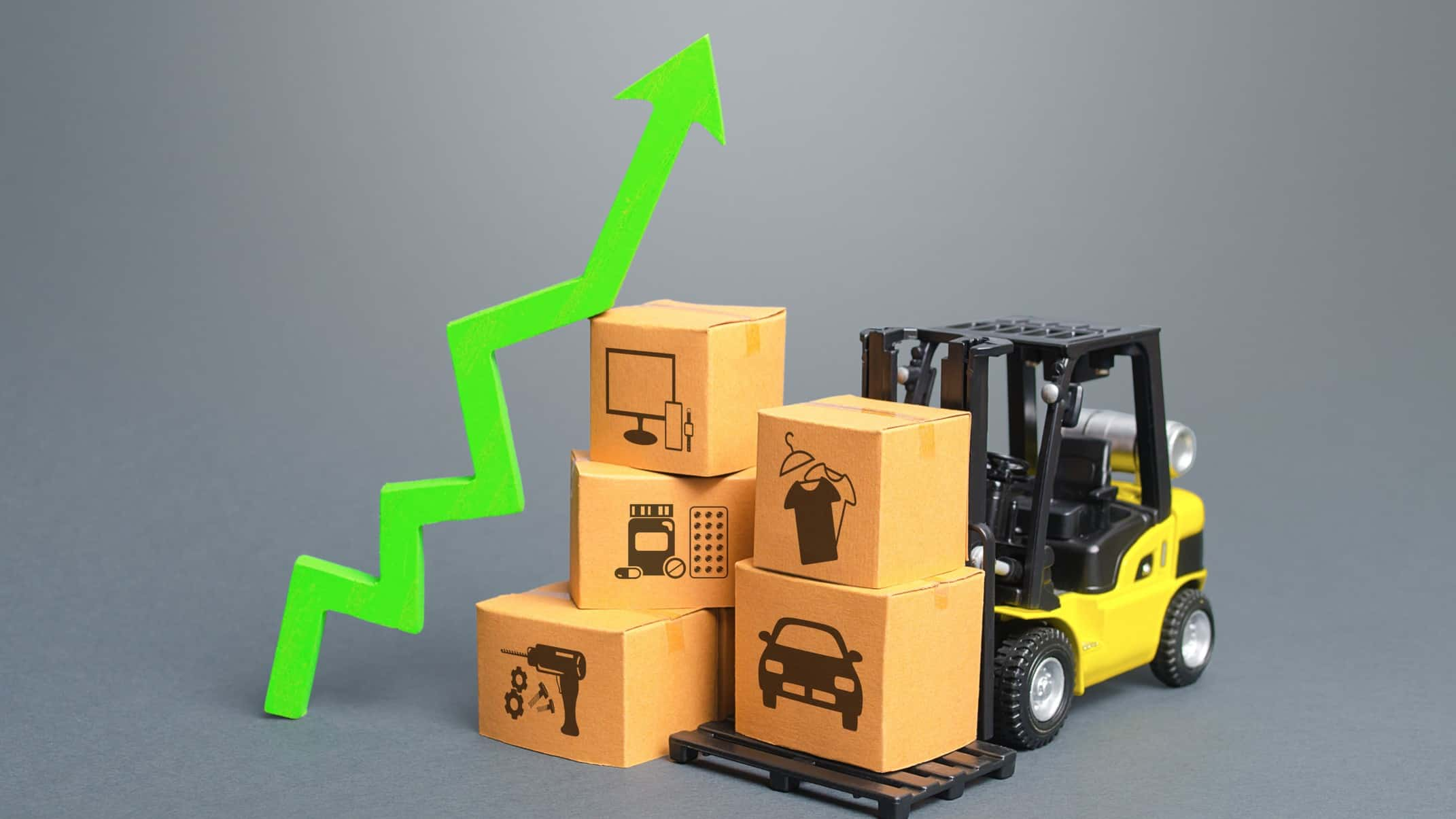 forklift holding boxes next to upward trending arrow signifying goodman group share price