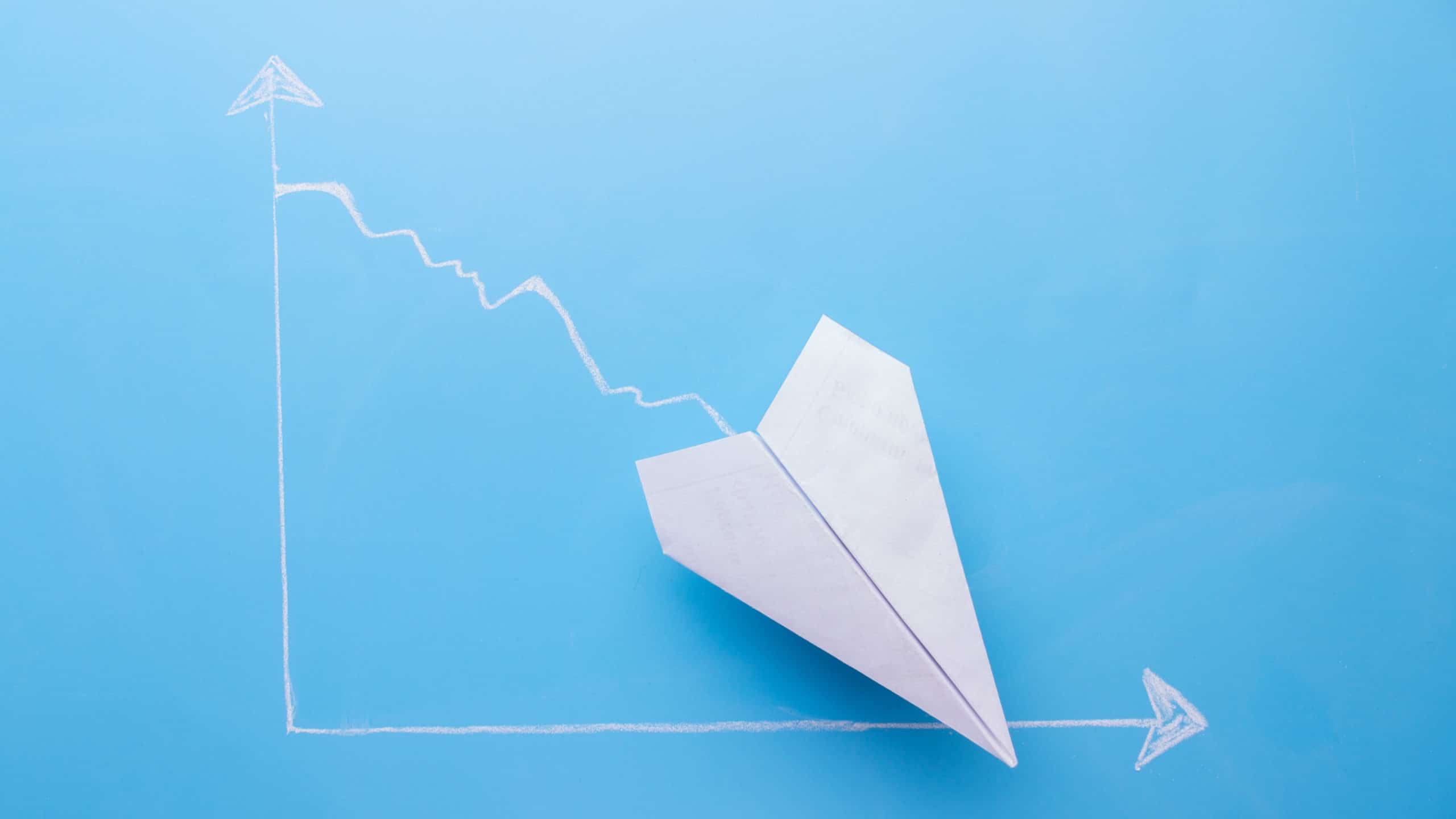 asx share price falling represented by graph of paper plane trending down