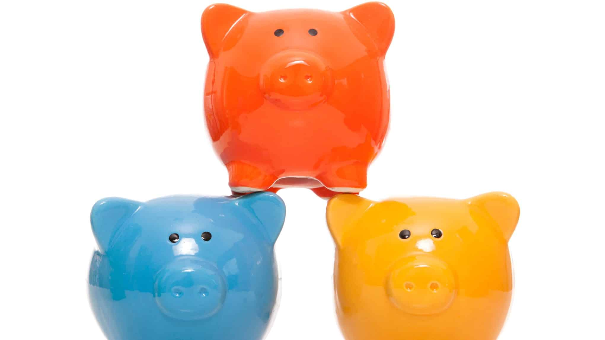 3 colourful piggy banks stacked up representing asx growth shares