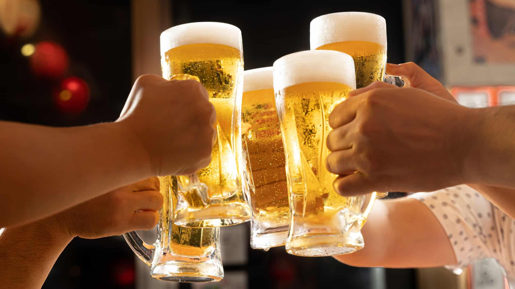 hospitality asx share price represented by people putting beer glasses together in cheers