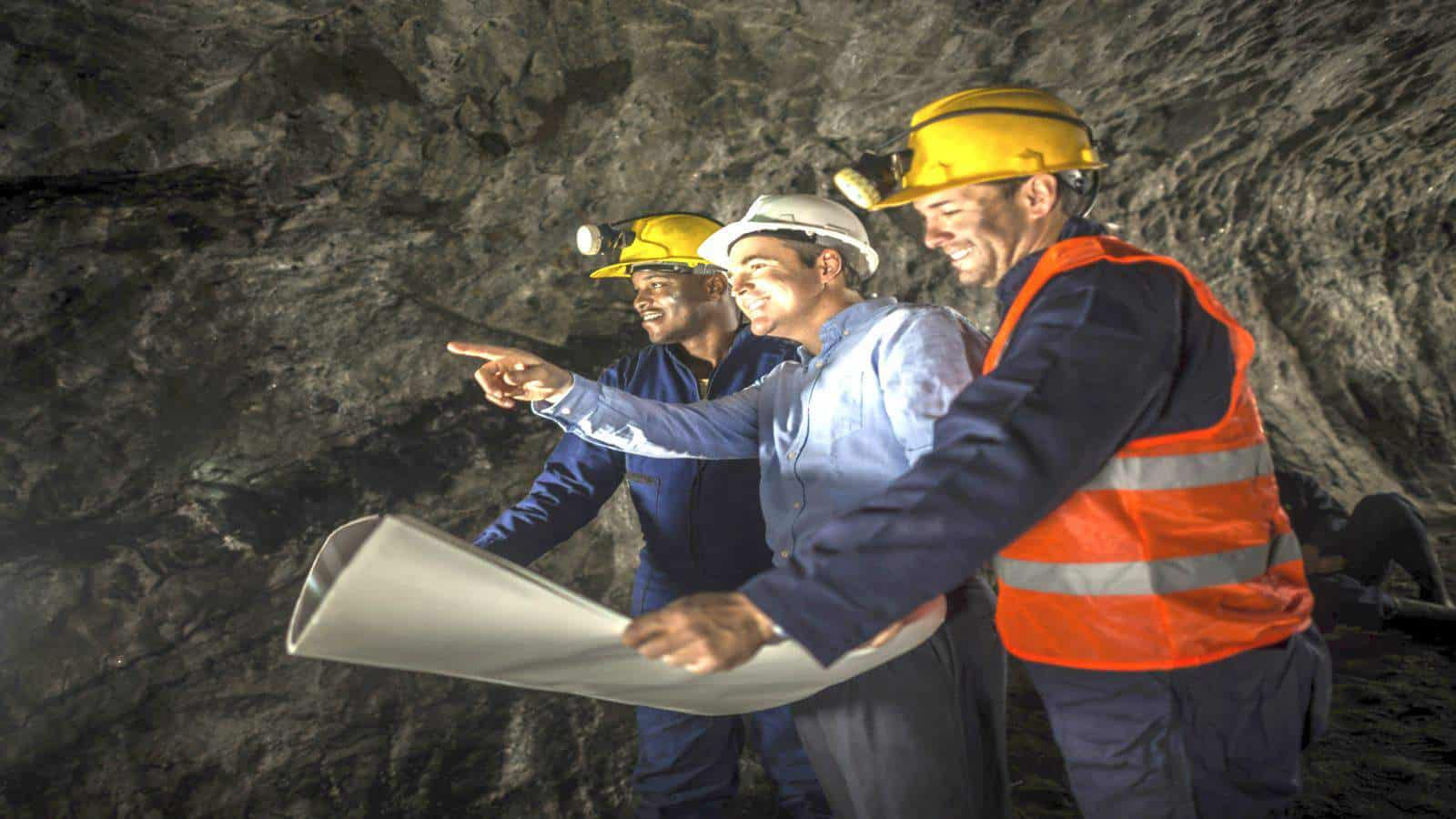 Miners working at the mine with an engineer representing Mineral Resources share price
