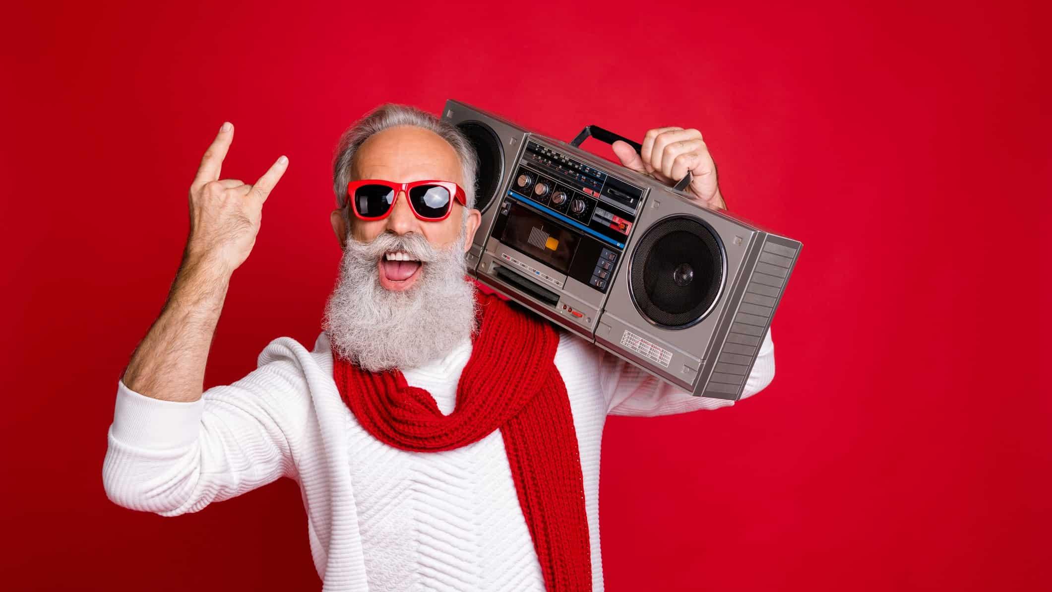 jb share price christmas boom represented by santa holding a hi-fi stereo