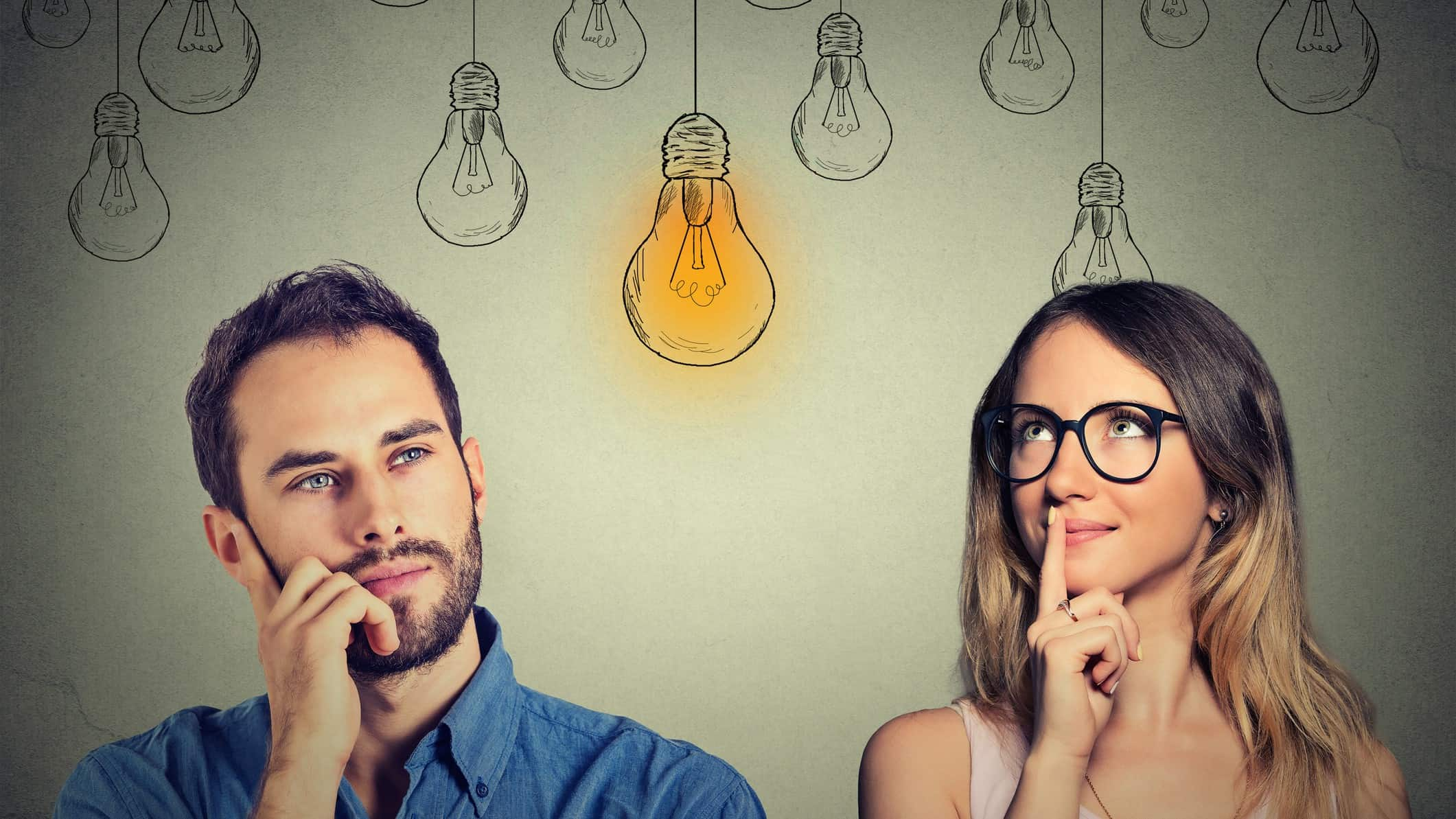 man and woman thinking with picture of lightbulbs