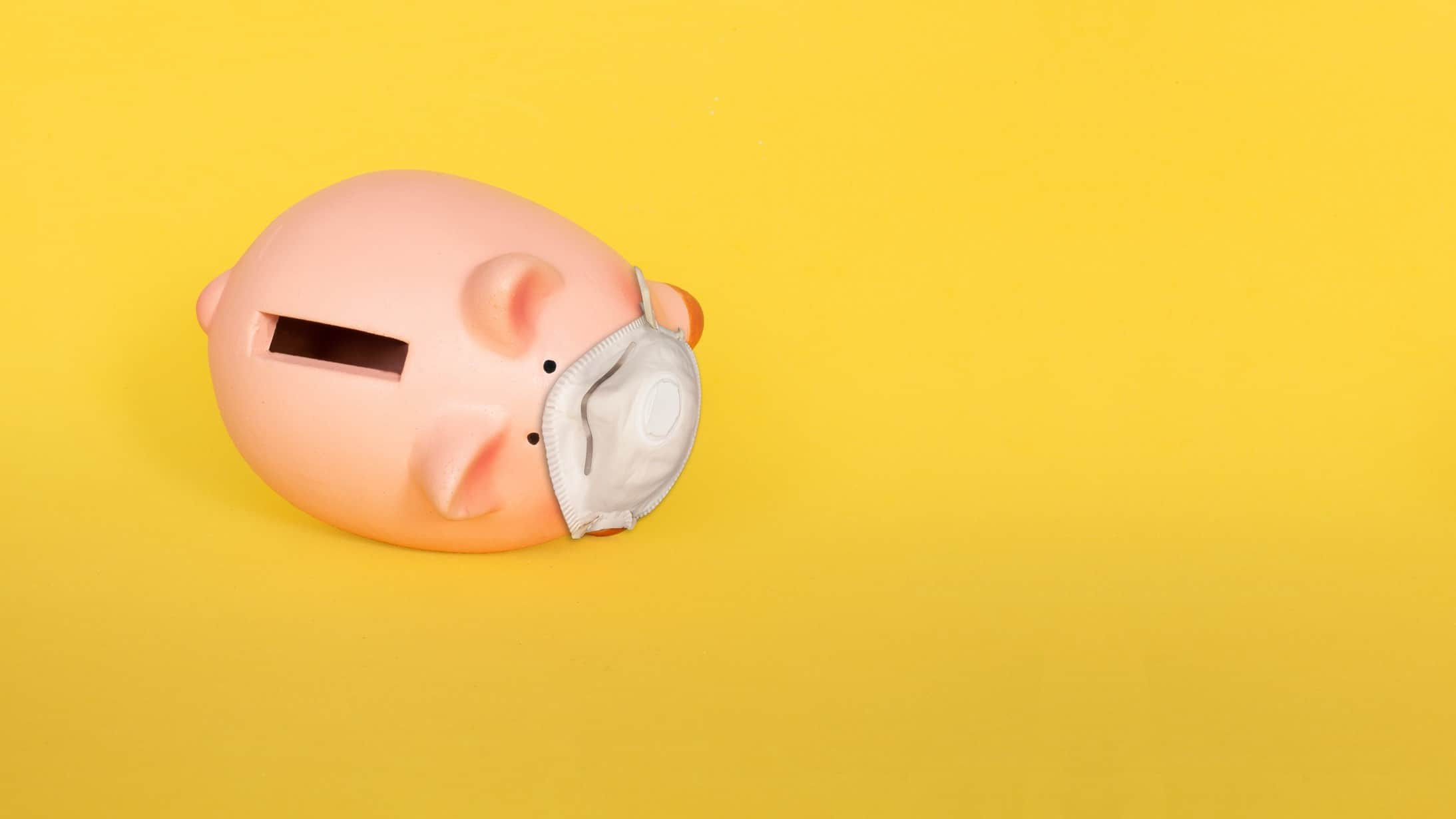 falling mayne pharma share price represented by piggy bank wearing doctor's mask having fallen over