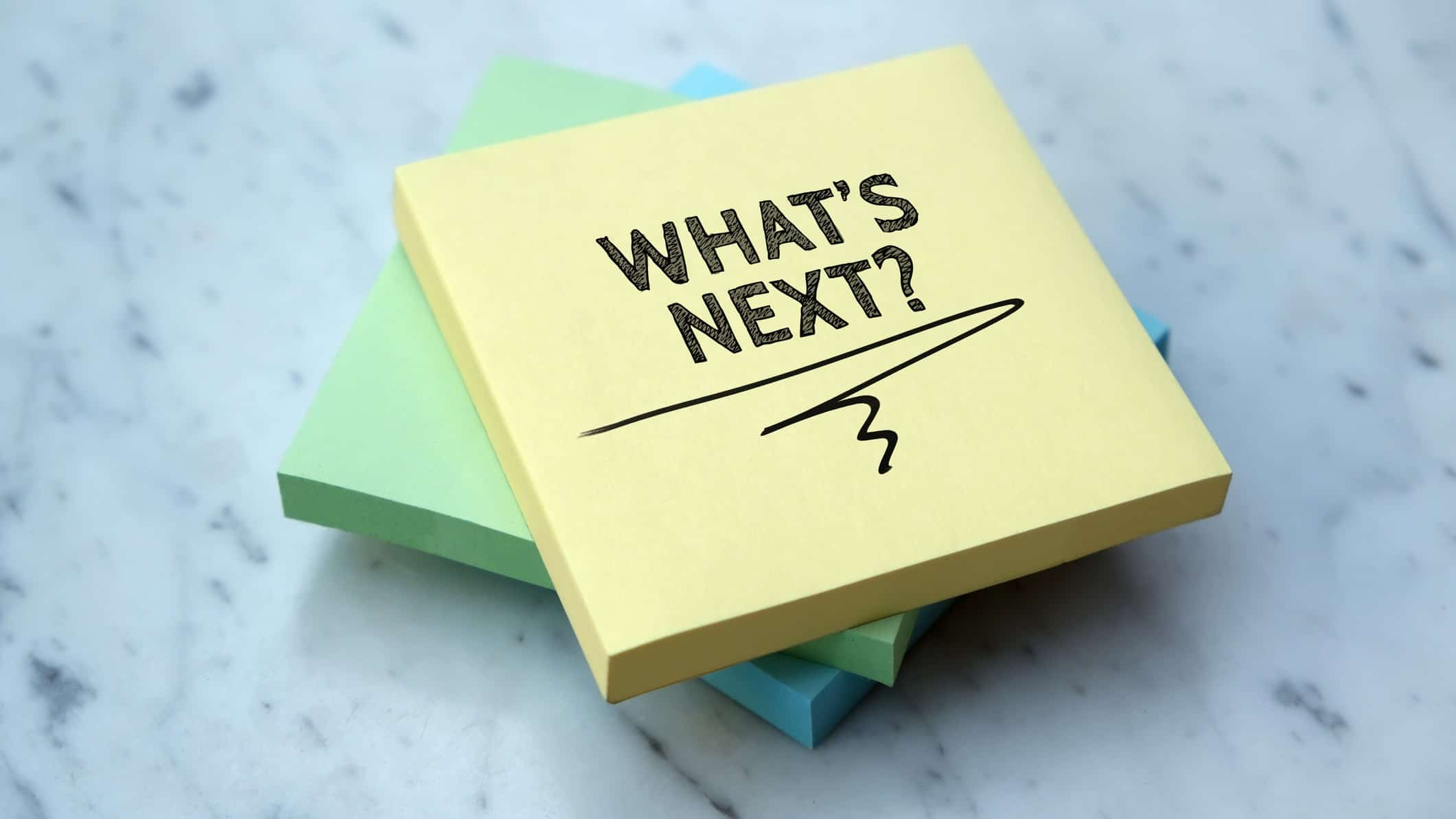 note pad with the words 'what's next' written on it representing uncertainty surrounding mcmillan share price