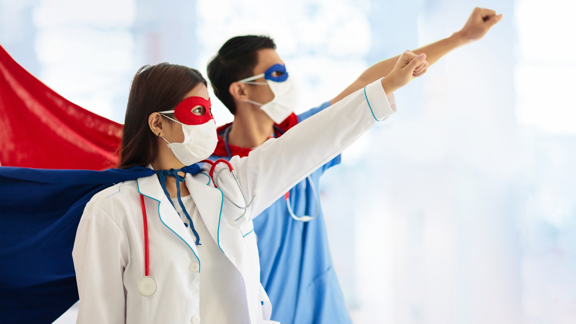 Medical staff wear hero capes, indicting strong shar [price performace for healthcare shares