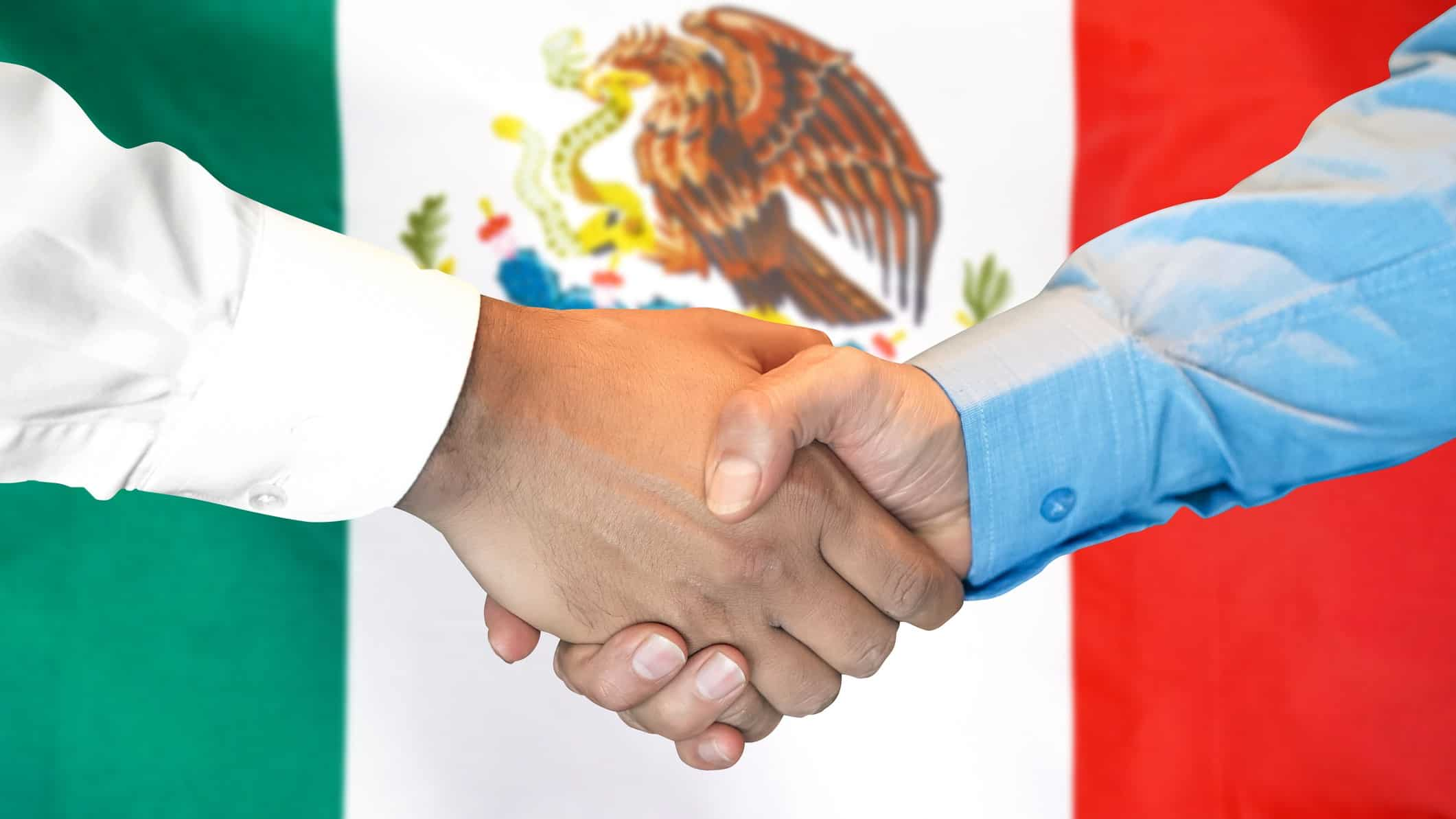increasing asx share price represented by two hands shaking in front of mexican flag