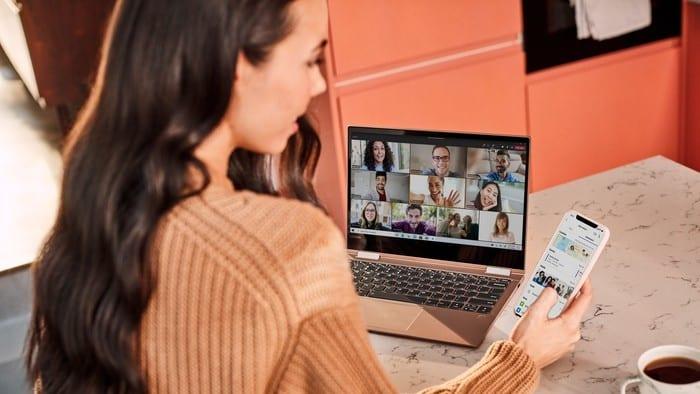 woman sitting at computer using Microsoft teams