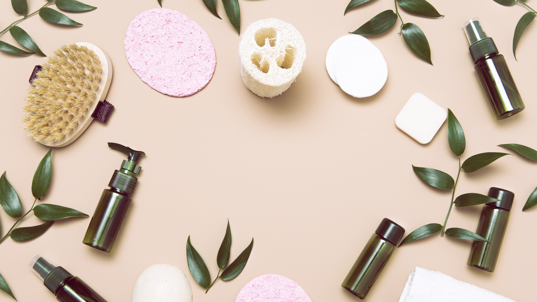 natural skin care asx share price represented by cosmetic bottles, leaves and sponges
