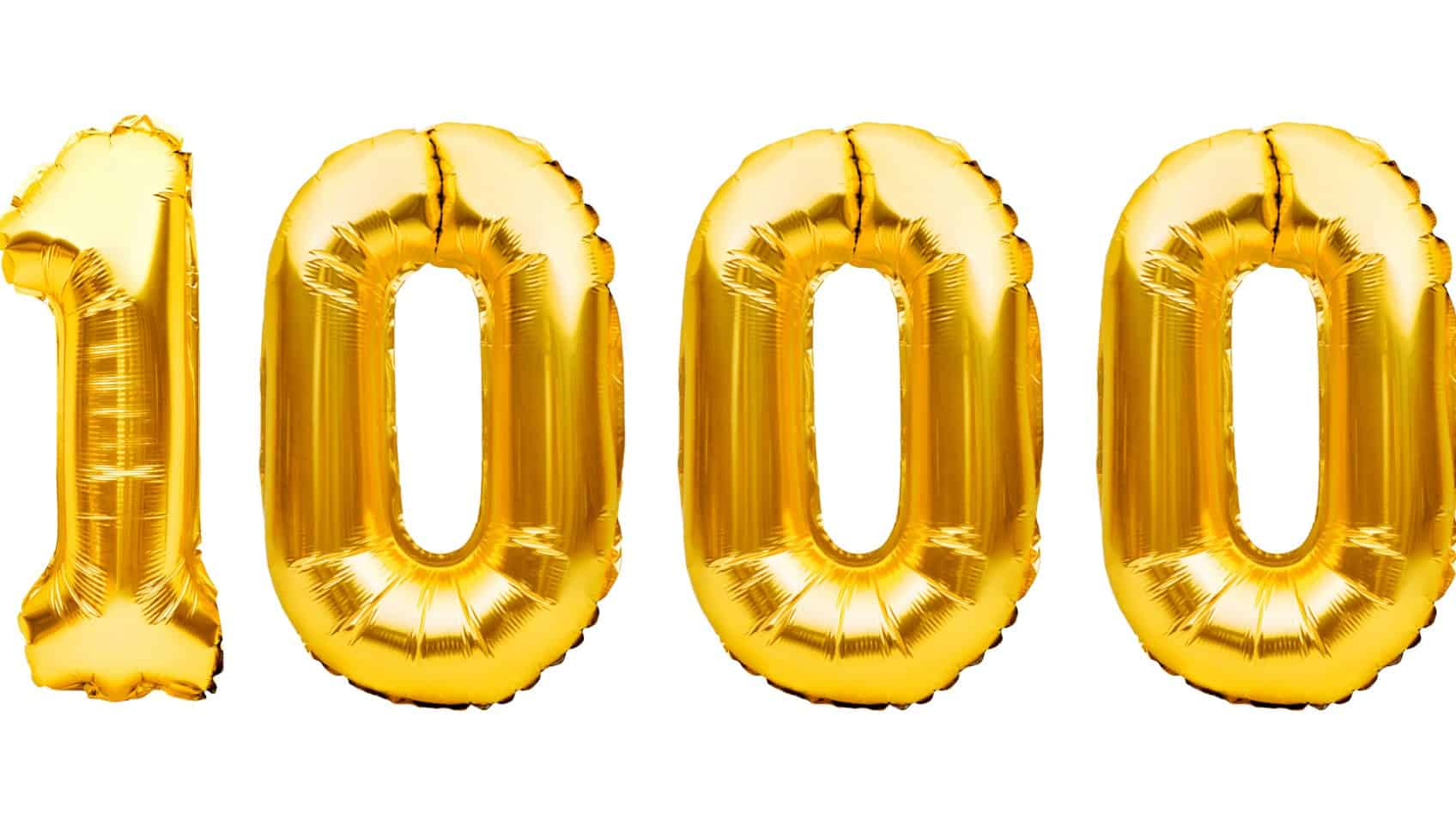 success of nearmap share price represented by gold baloons spelling out one thousand