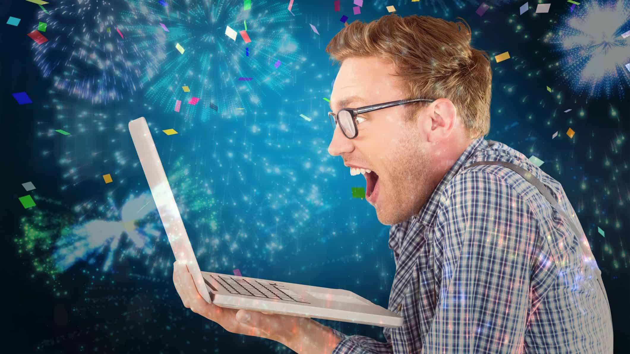 Man looking excitedly at ASX share price gains on computer screen against backdrop of streamers
