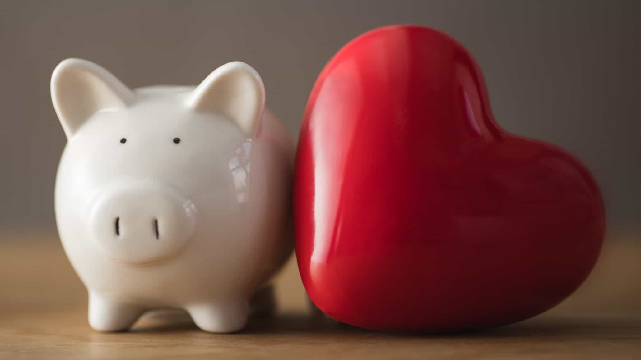 piggy bank next to big red heart representing osprey share price