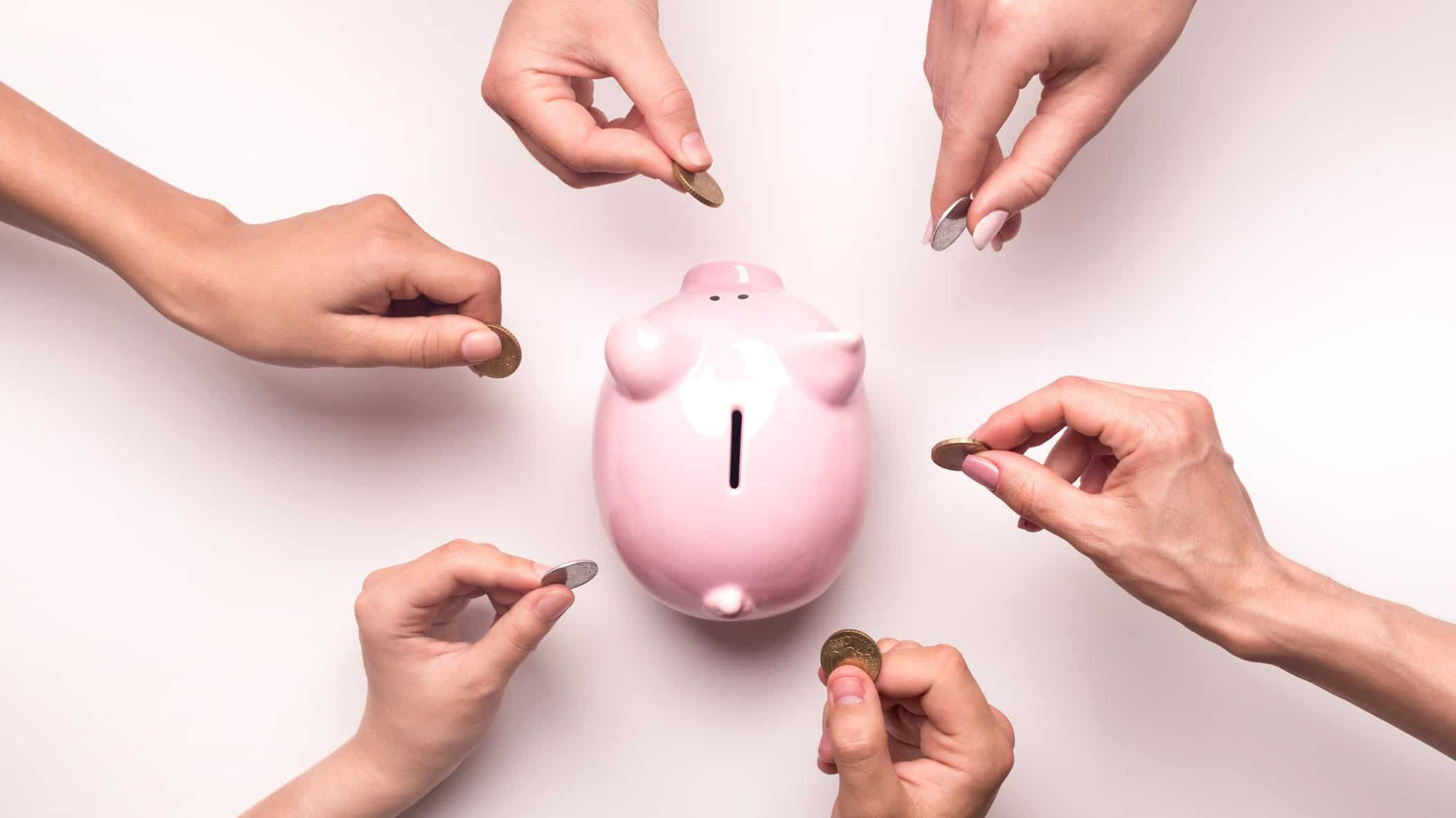 growth in asx share price represented by multiple hands all placing coins in a piggy bank
