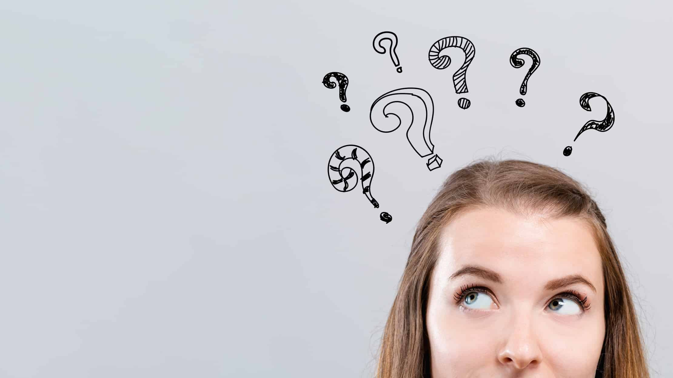Questioning asx share price represented by women with virtual question marks above her head