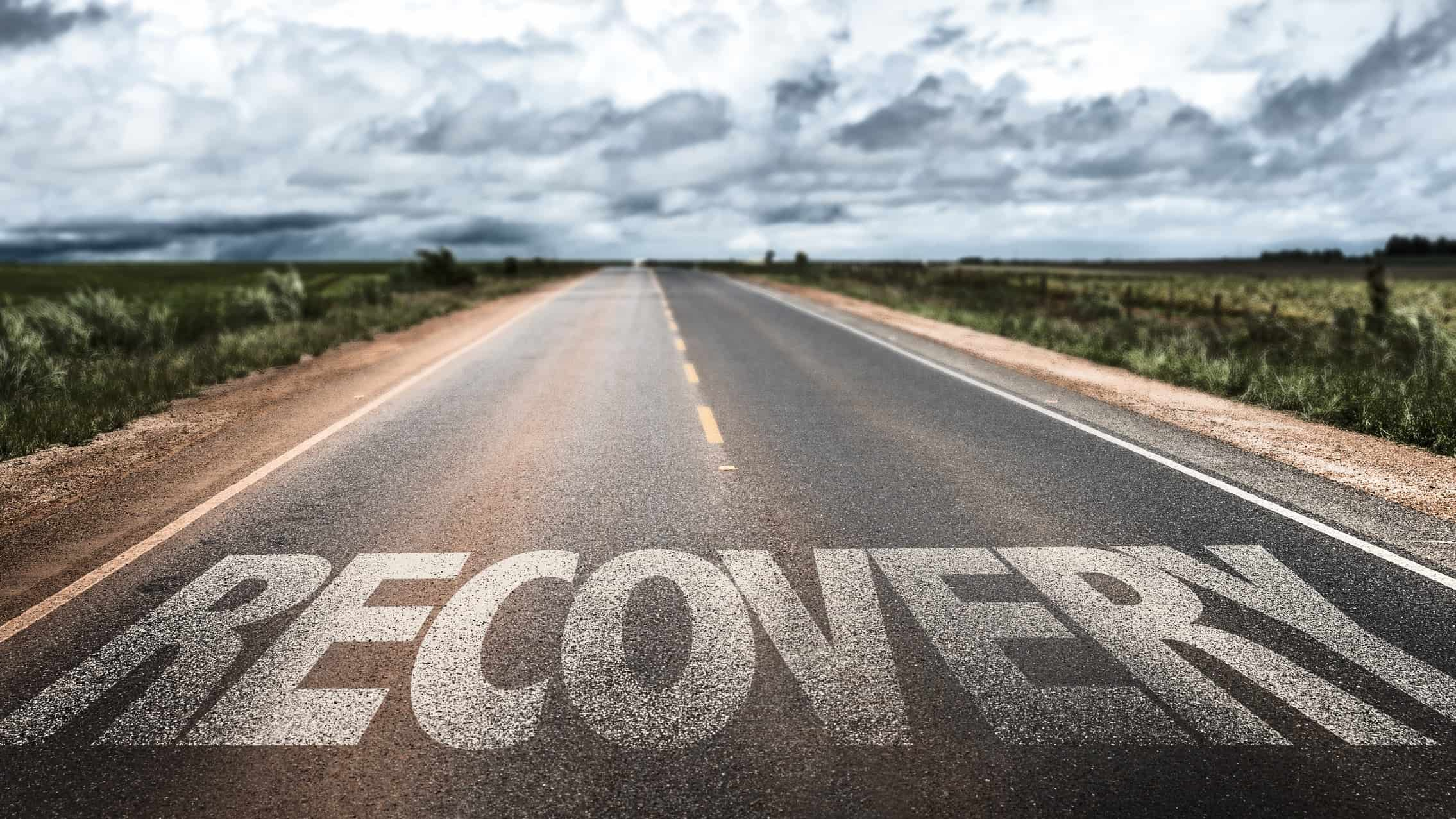road in the country with word recovery printed on it