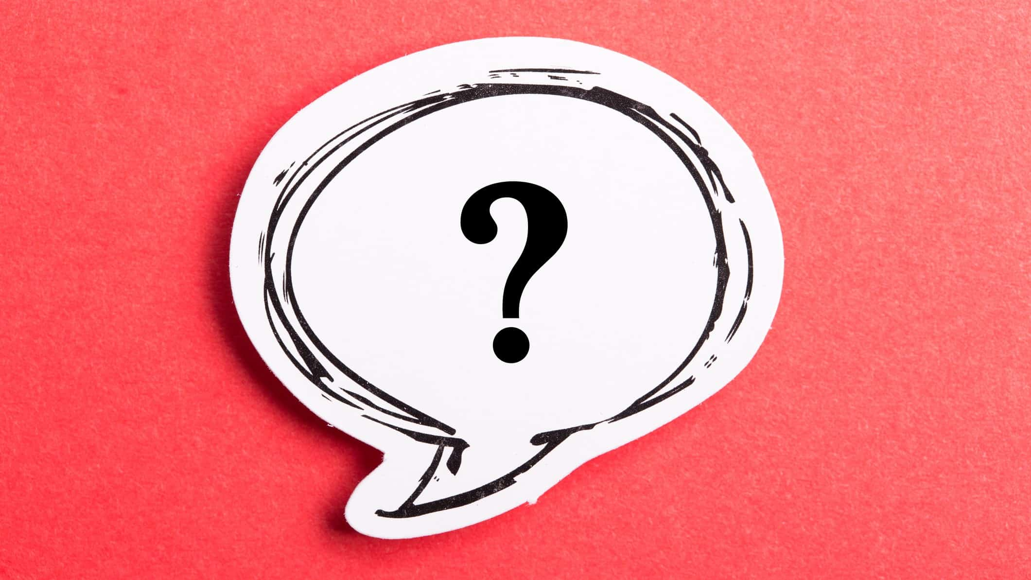 Speech bubble containing question mark against red background representing question of whether red bubble share price will burst