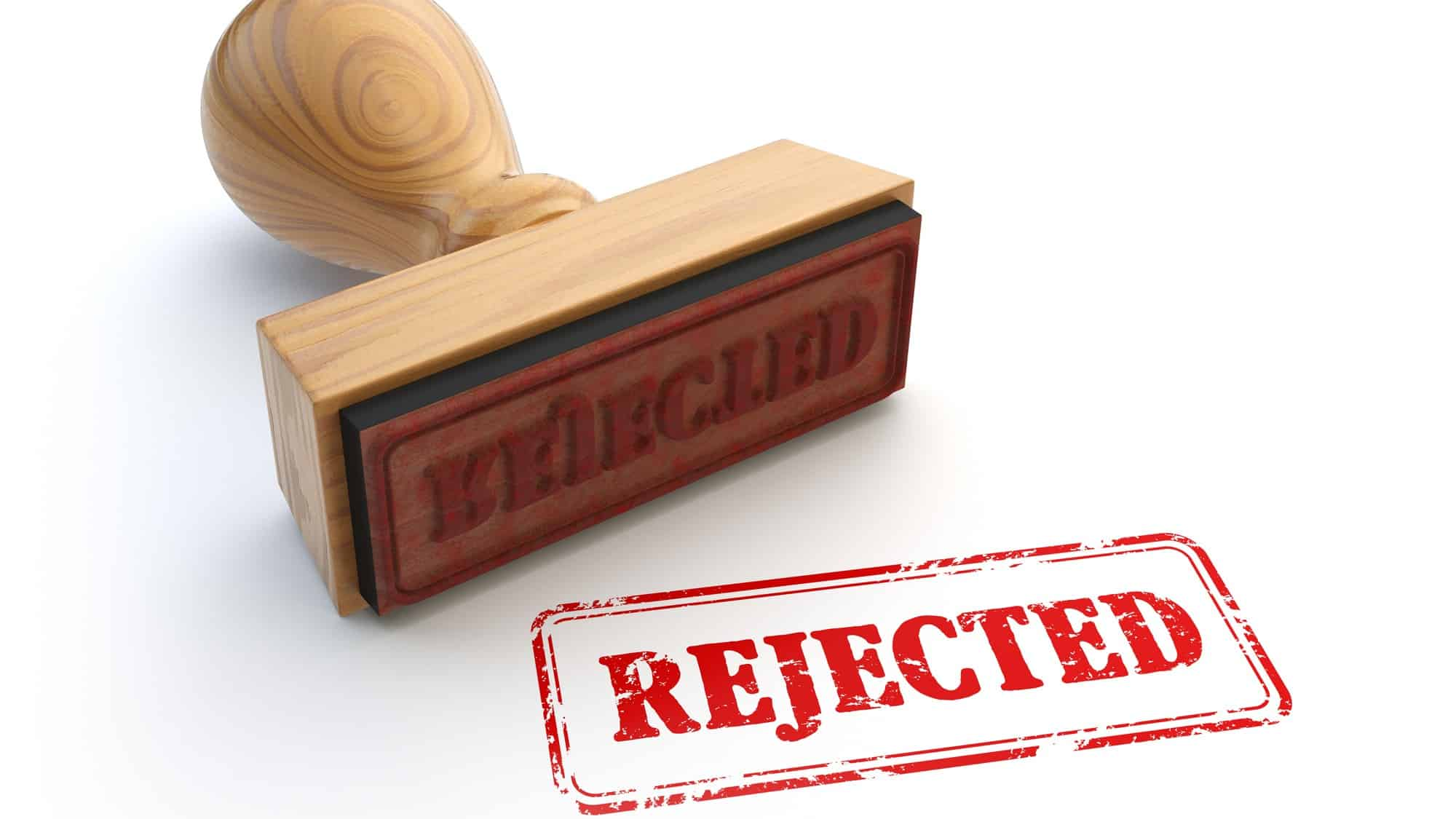 rubber stamp stamping 'rejected' on paper representing falling reject shop share price