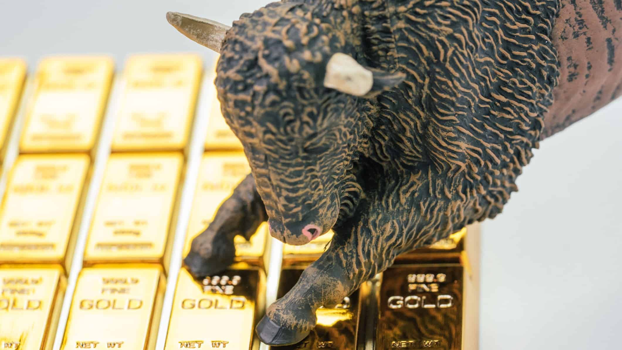 figurine of a bull standing on gold bars