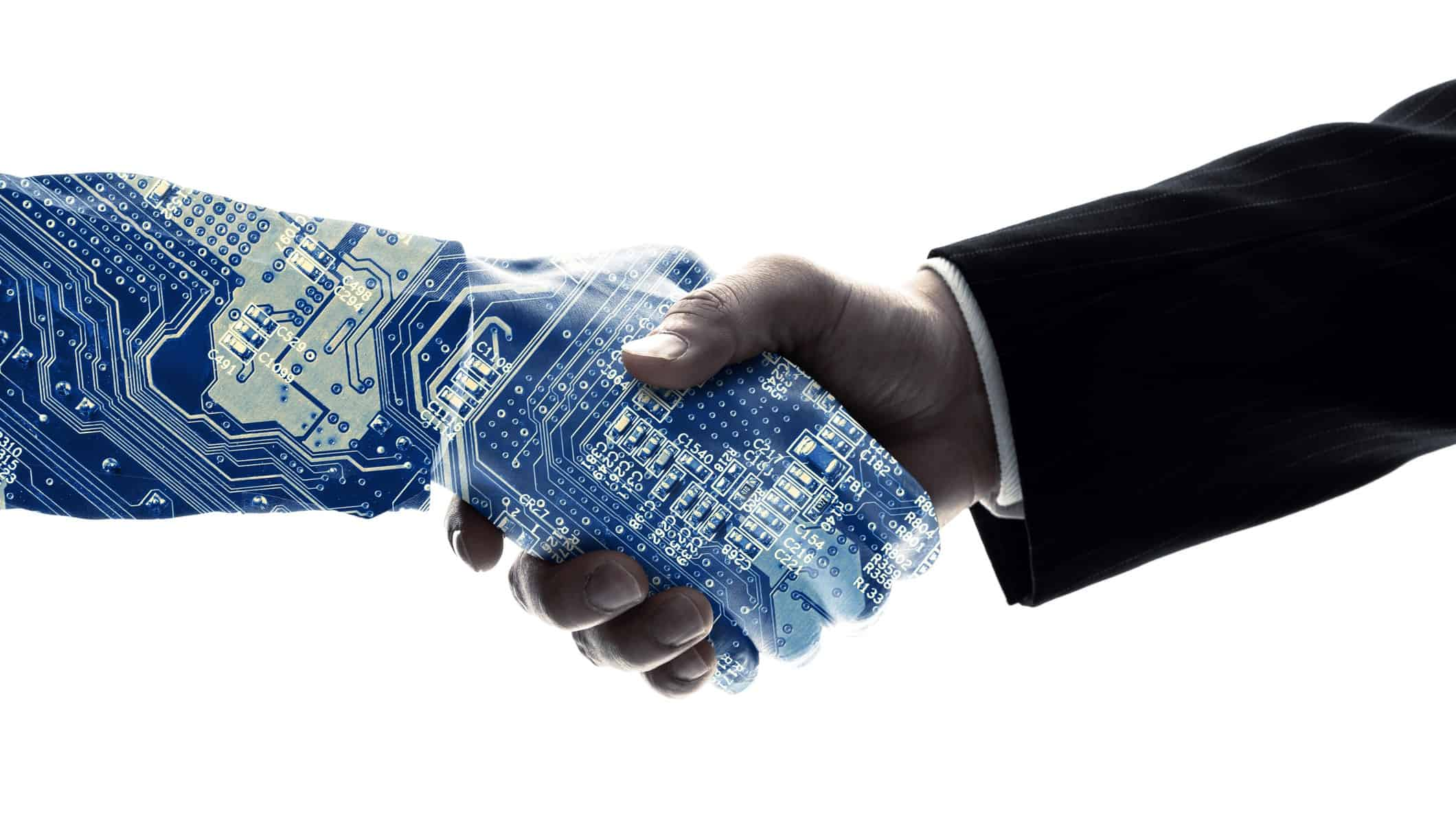 two harms shaking hands with one arm appearing as a circuit board representing senetas share price