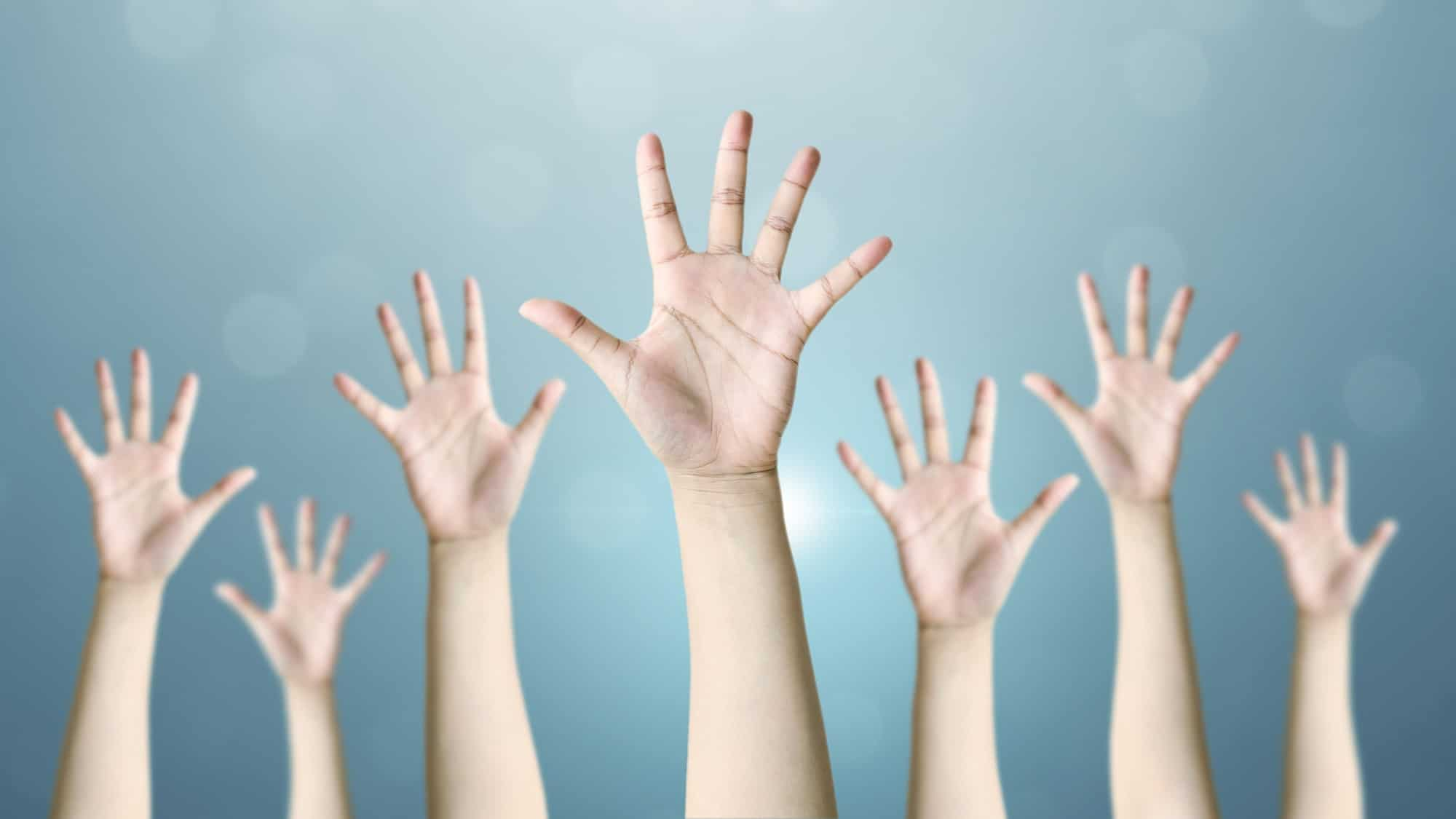 asx share price vote represented by lots of hands up in the air