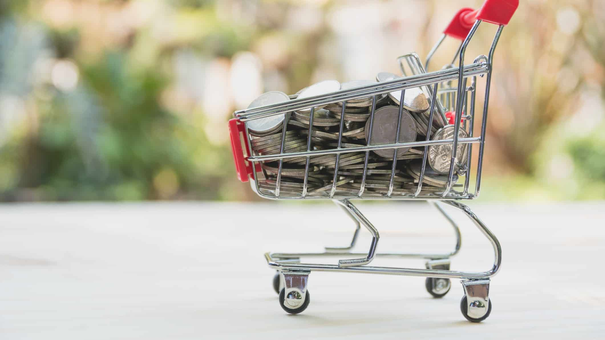 shopping trolley filled with coins representing asx retail share price.ce