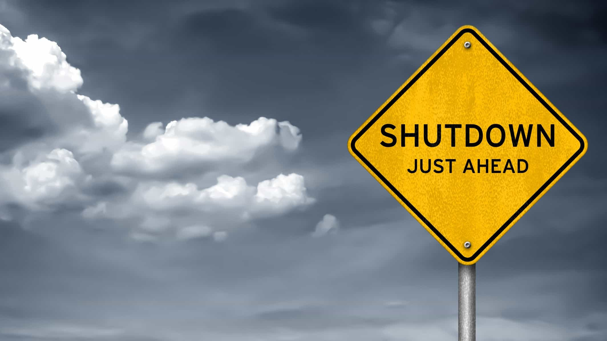 shutdown relating to asx shares and etfs represented by road sign stating shutdown ahead