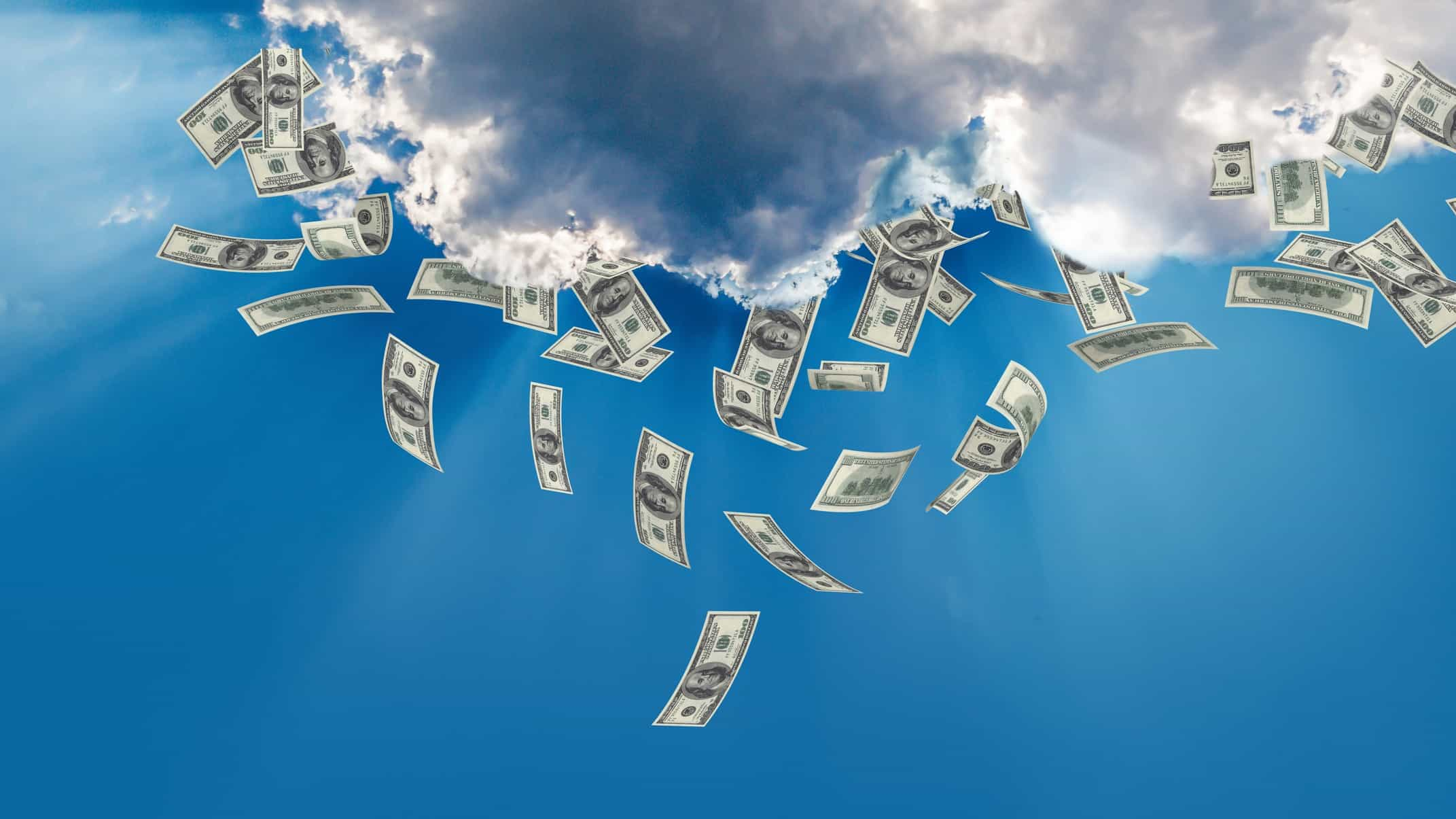 Cloud against blue sky with cash falling from it representing rich investors