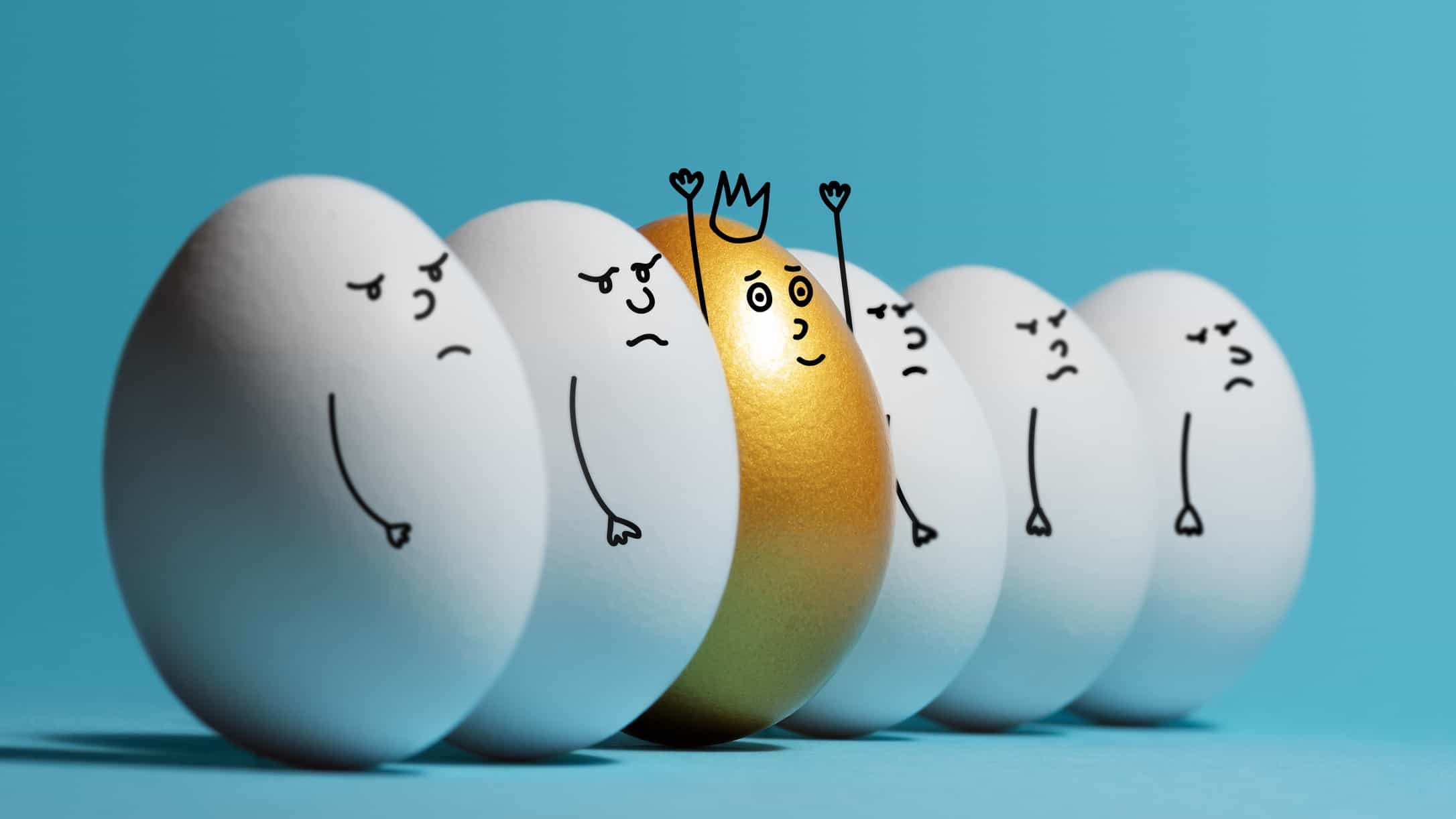 row of white eggs with cartoon sad faces with one gold egg with happy face and crown representing high performing asx share