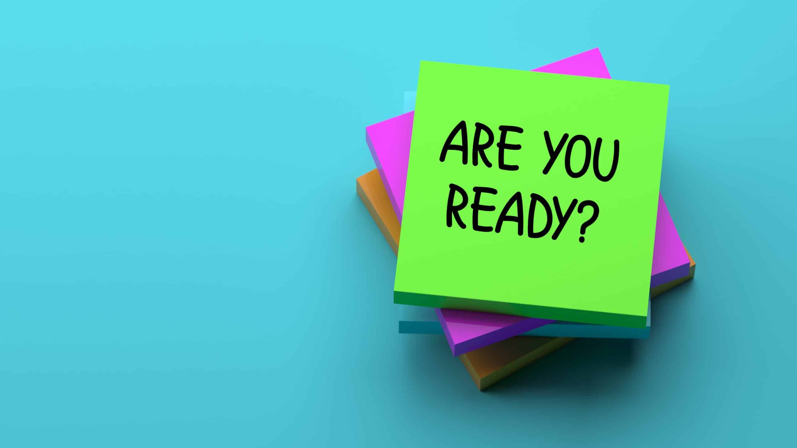 pile of post-it note pads with top one saying 'are you ready?'