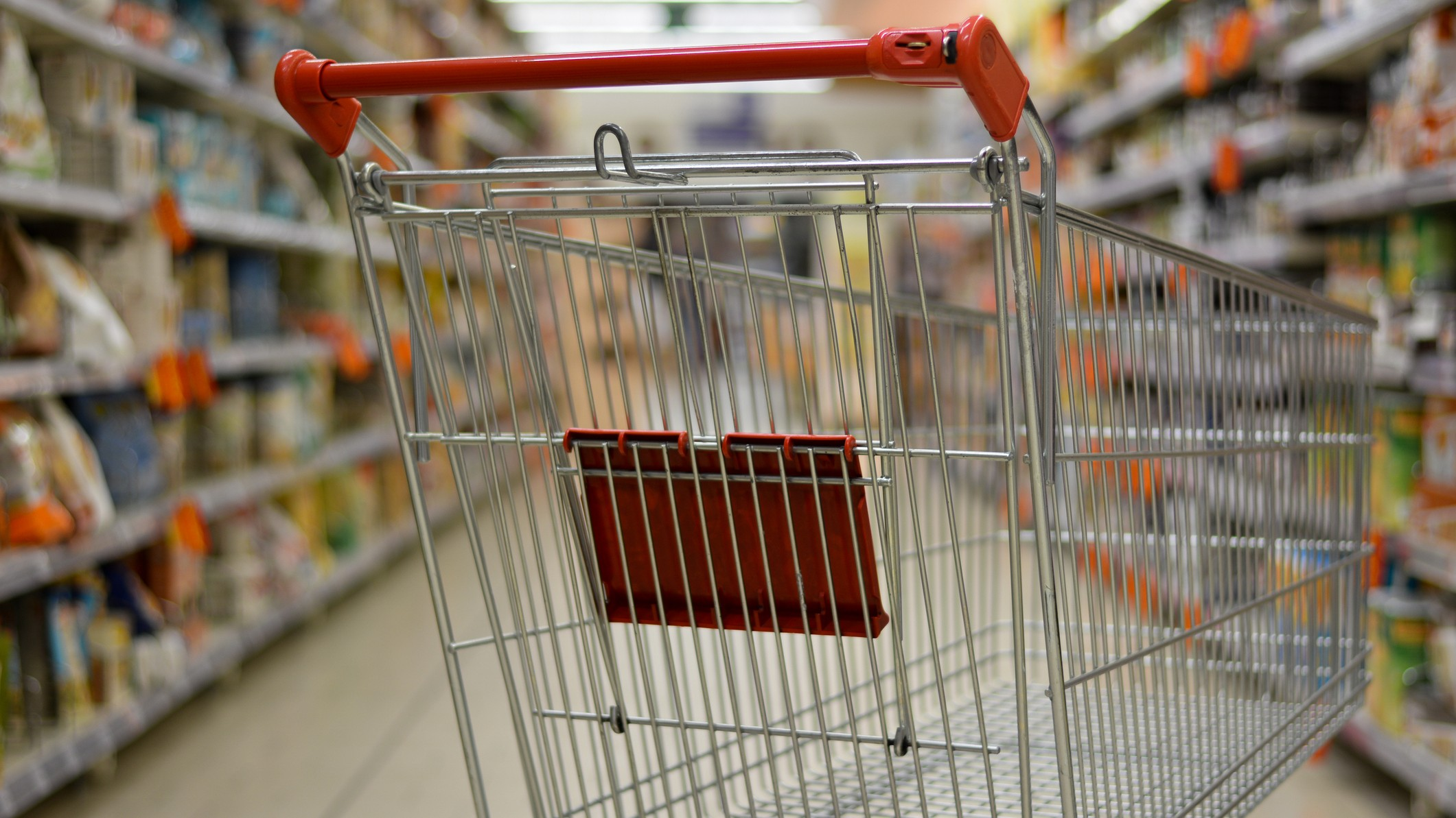 supermarket asx shares represented by shopping trolley in supermarket aisle