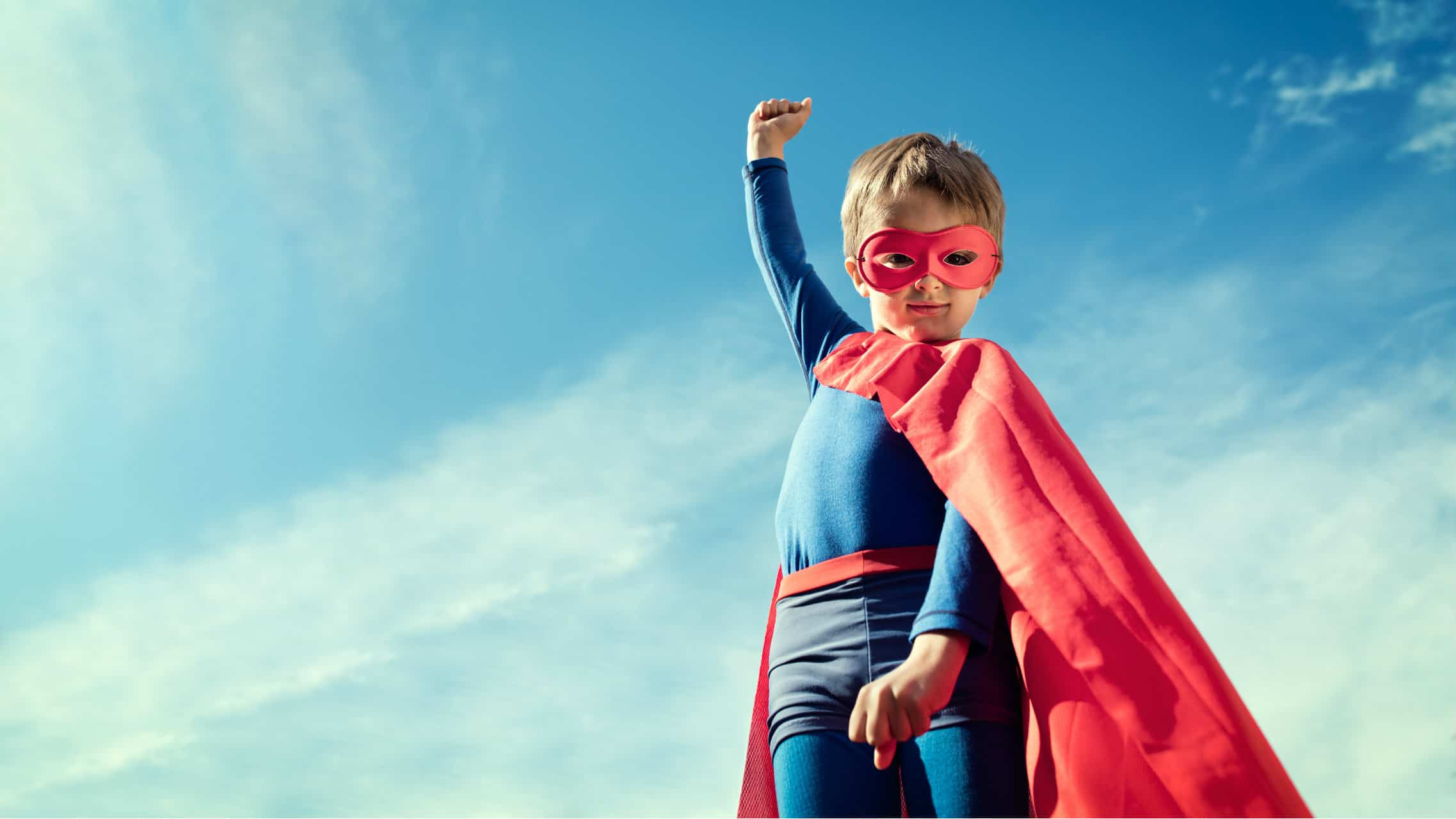 child in a superman outfit