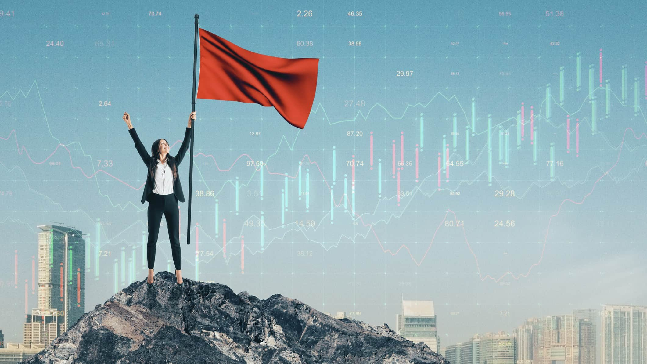 woman holding flagpole on top of peak against backdrop of city and stock chart