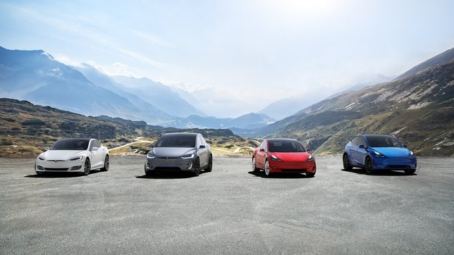 tesla stock represented by four tesla cars parked on mountain top