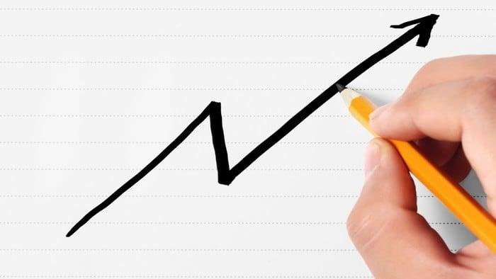 hand drawing increasing line graph representing rising Tesla stock