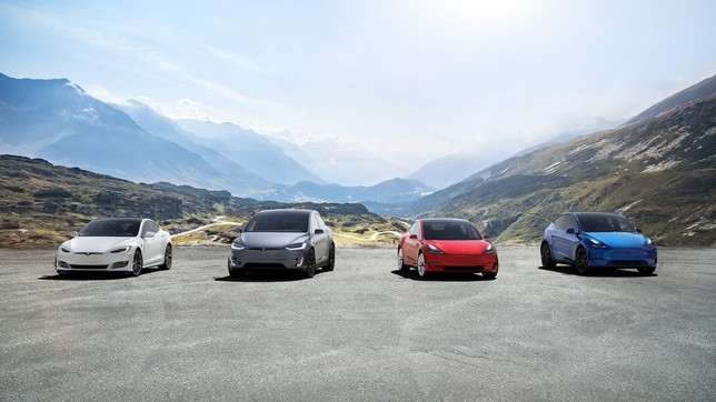 Tesla stock represented by four tesla electric vehicles parked against mountain backdrop