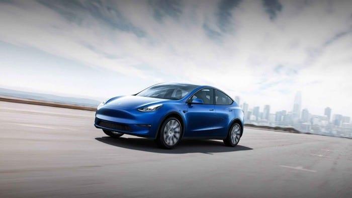 Tesla car driving along