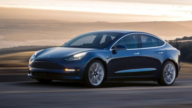 electric vehicle made by Tesla on the road.