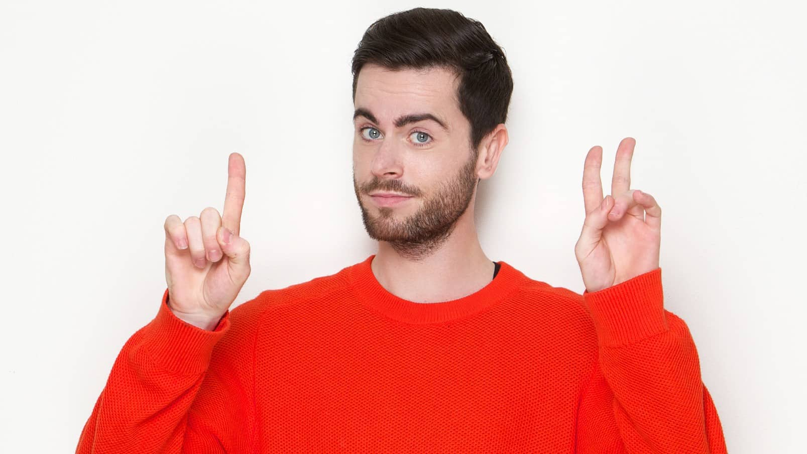 three reasons to buy asx shares represented by man in red jumper holding up three fingers