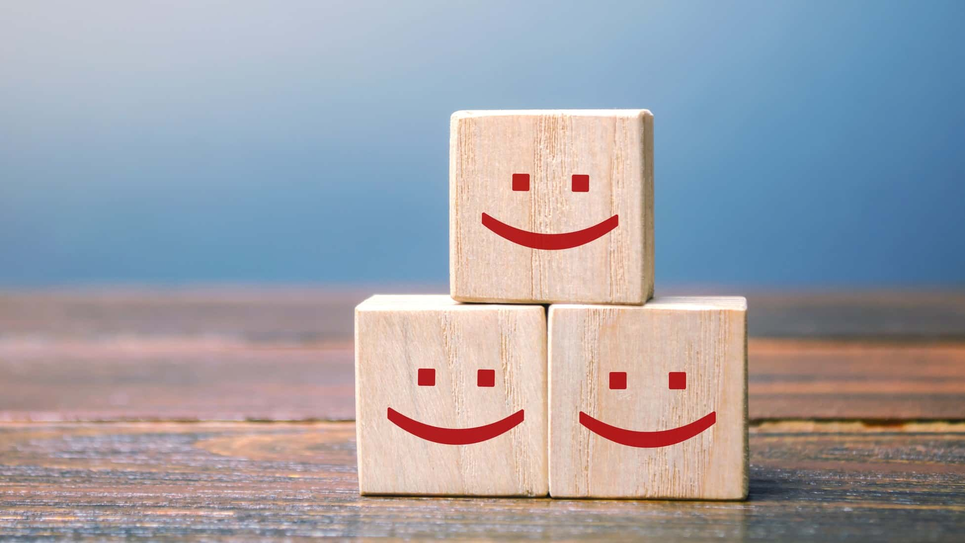 three building blocks with smiley faces, indicating a rise in the ASX share price