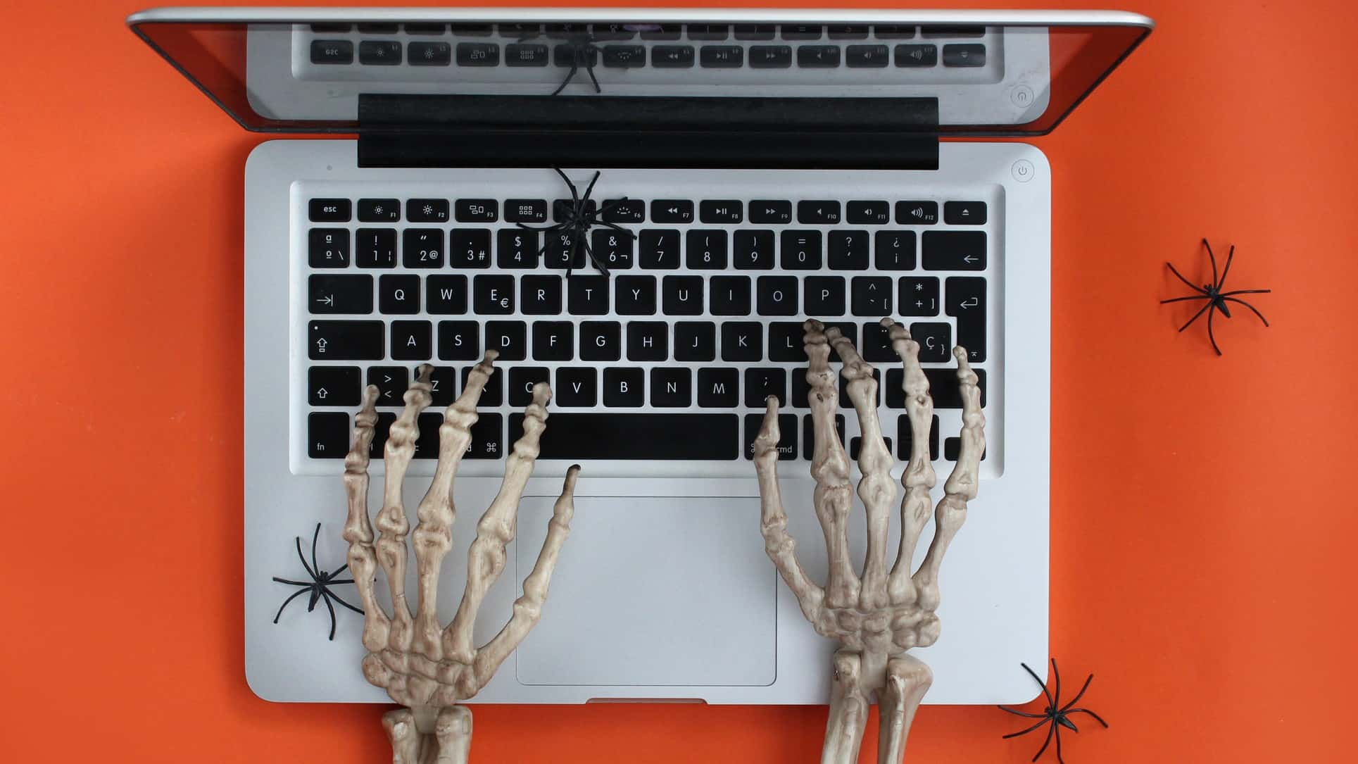 skeleton hands typing on laptop signifying that value investing is dead